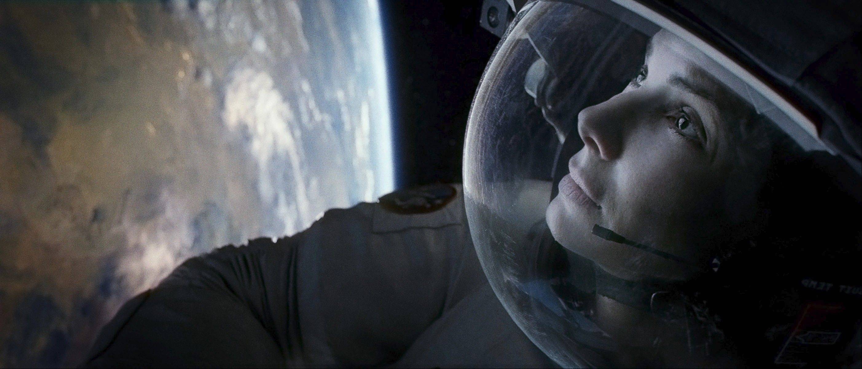 "Sandra Bullock plays Dr. Ryan Stone from Lake Zurich in the special-effects stuffed survival thriller ""Gravity."""