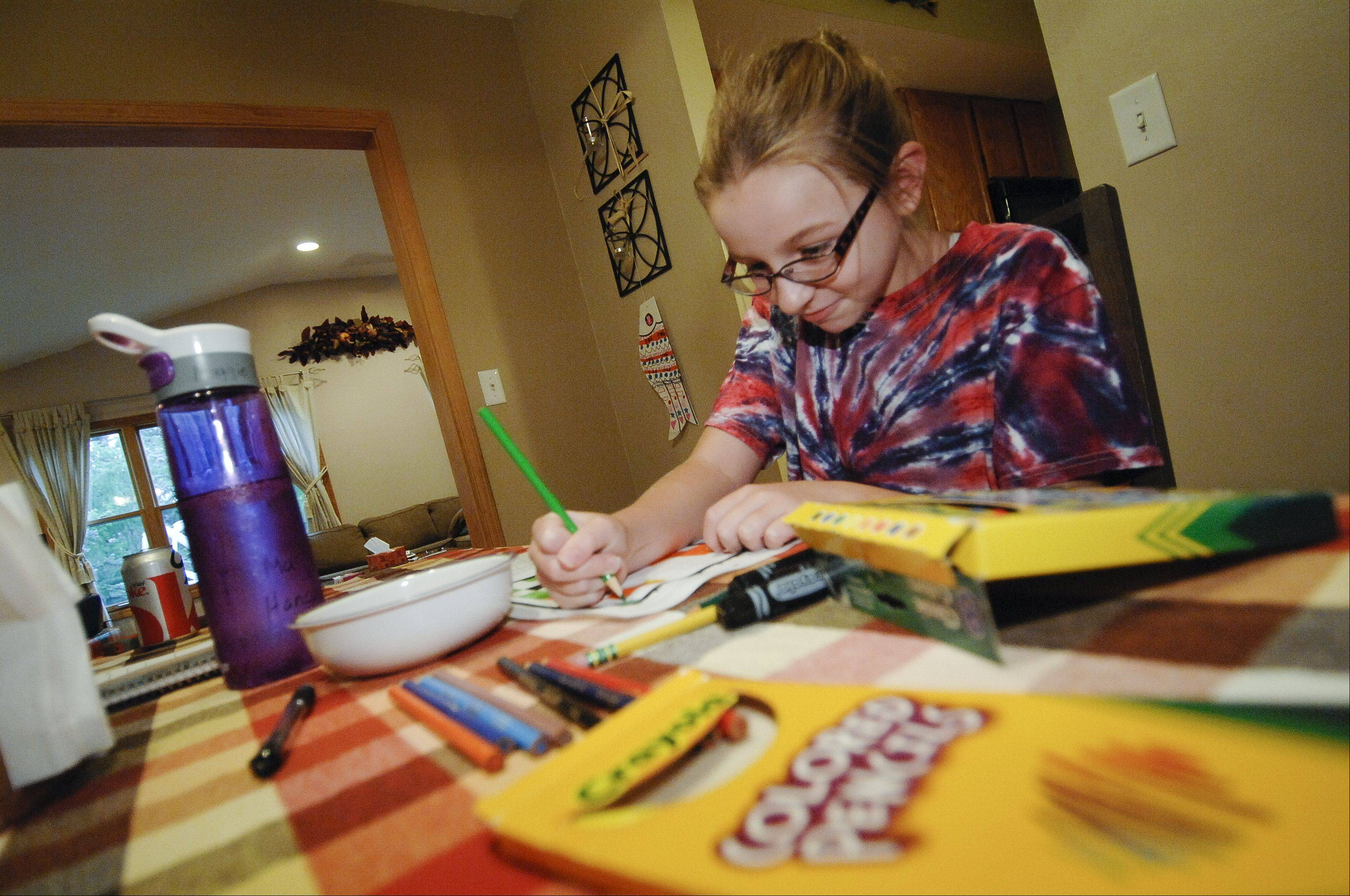 Maggie Hancock, 9, of Carol Stream makes sure to study well to cut down on the stress of taking a test. Test anxiety can be a trigger for nausea for many children.