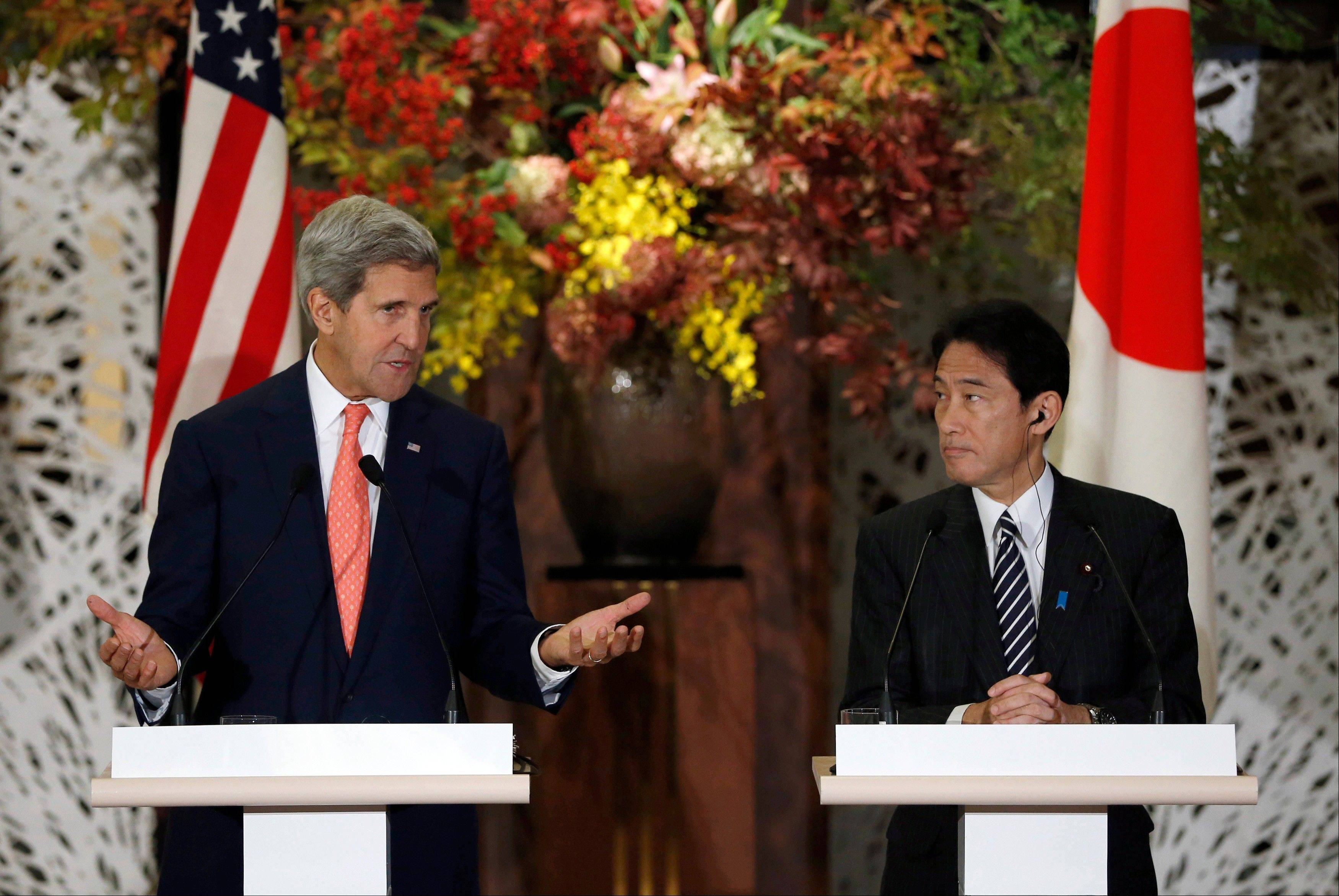 U.S. Secretary of State John Kerry, left, and Japan's Foreign Minister Fumio Kishida, right, attend their joint news conference with U.S. Secretary of Defense Chuck Hagel and Japan's Defense Minister Itsunori Onodera after the Japan-U.S. security talks in Tokyo Thursday, Oct. 3, 2013.