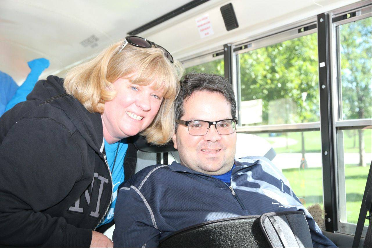 Kris and Paul Launer of North Barrington on one of the two buses their Iron Horse Brigade team took to the Les Turner ALS Foundation's Walk For Life last month at Soldier Field. The team raised the most money of any of the event's approximately 200 entries.