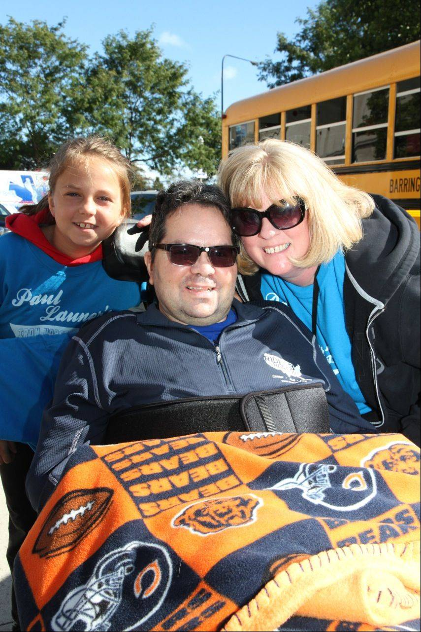 Aubrey Launer with her parents Paul and Kris of North Barrington at the Les Turner ALS Foundation's Walk For Life Sept. 22 at Soldier Field in Chicago.