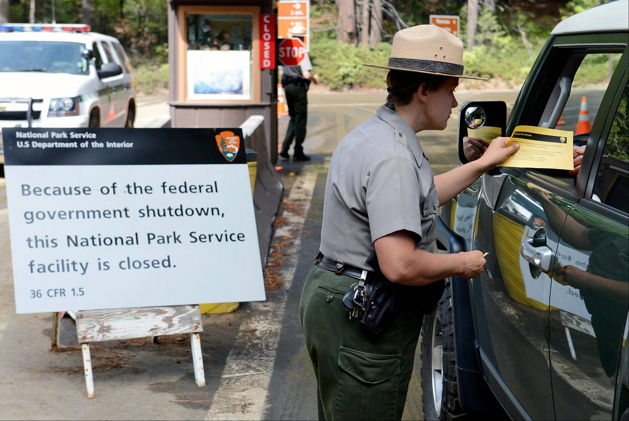 U.S. park ranger Heidi Schlichting informs visitors of the closure of Yosemite National Park, Calif., of the closure of the park due to the government shutdown.