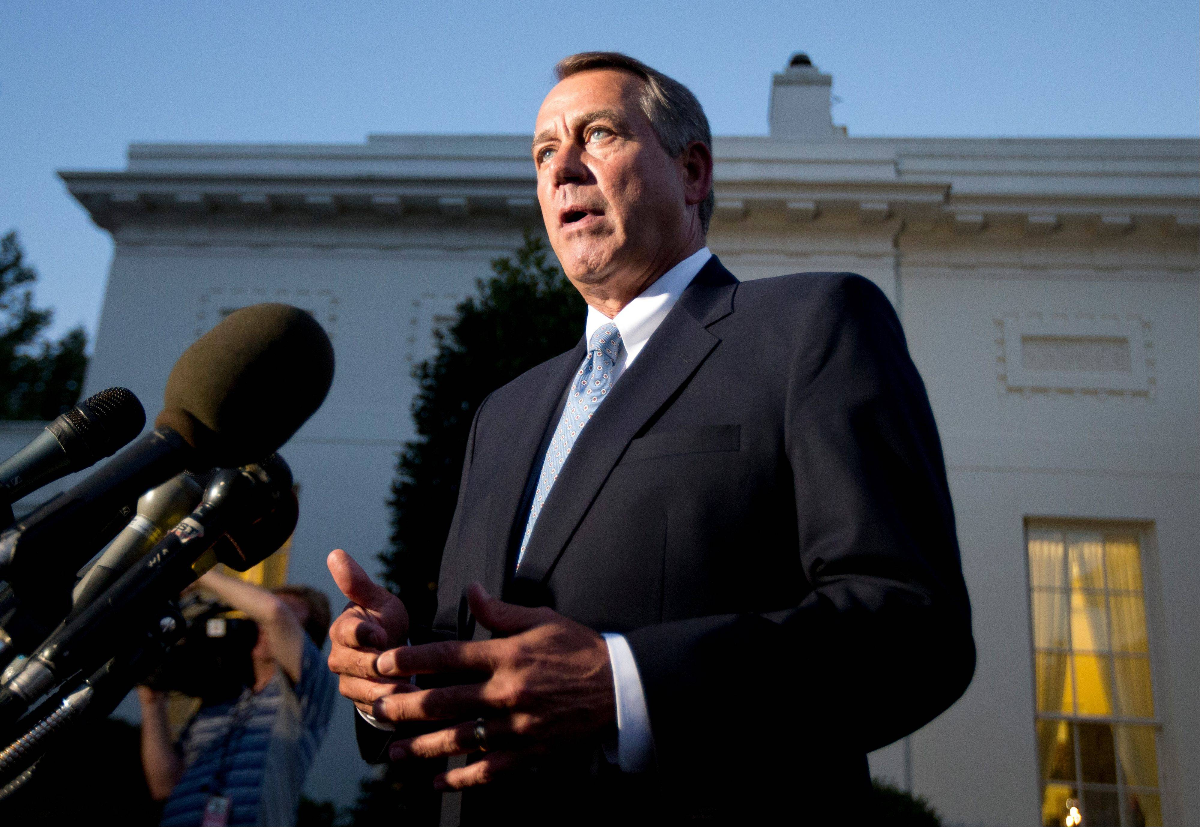 House Speaker John Boehner, an Ohio Republican, speaks to reporters following a meeting with President Barack Obama at the White House on Wednesday.