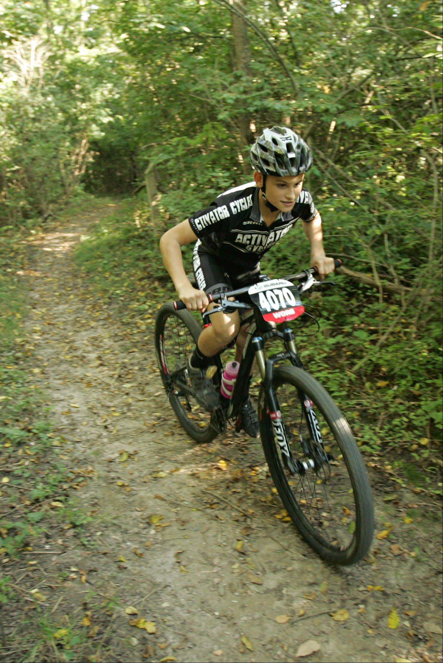 Will Darling, 12, of Vernon Hills makes quick work of a short climb through trails at Raceway Woods in Carpentersville. Will and his best friend, Nate Knowles, 12, of Batavia, are ranked by USA Cycling among the best cross-country mountain bikers in the nation.