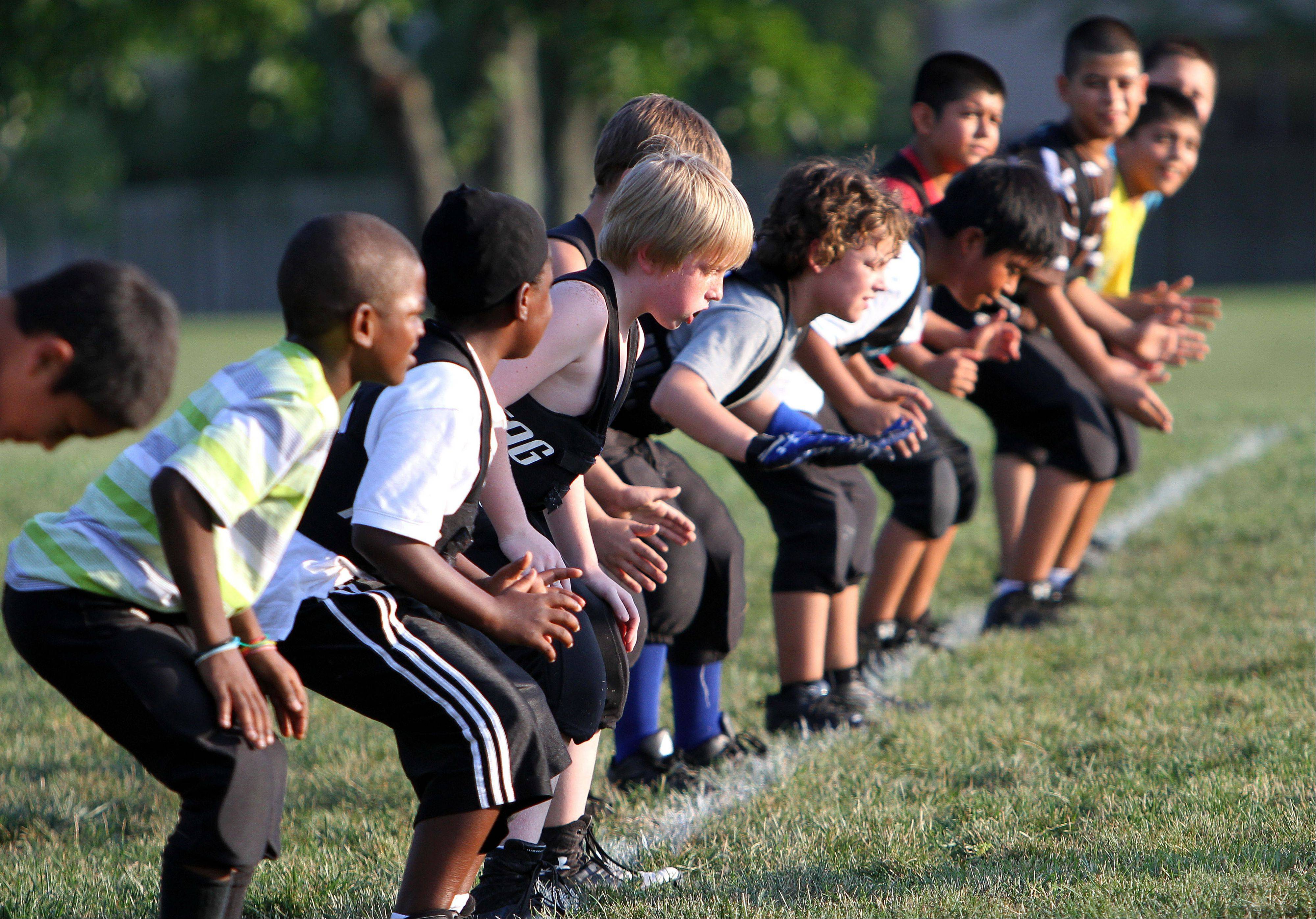 The Ela Junior Bears youth football team practices at Knox Field in Lake Zurich. The team has opened to children who previously could not afford to join a youth sports team.