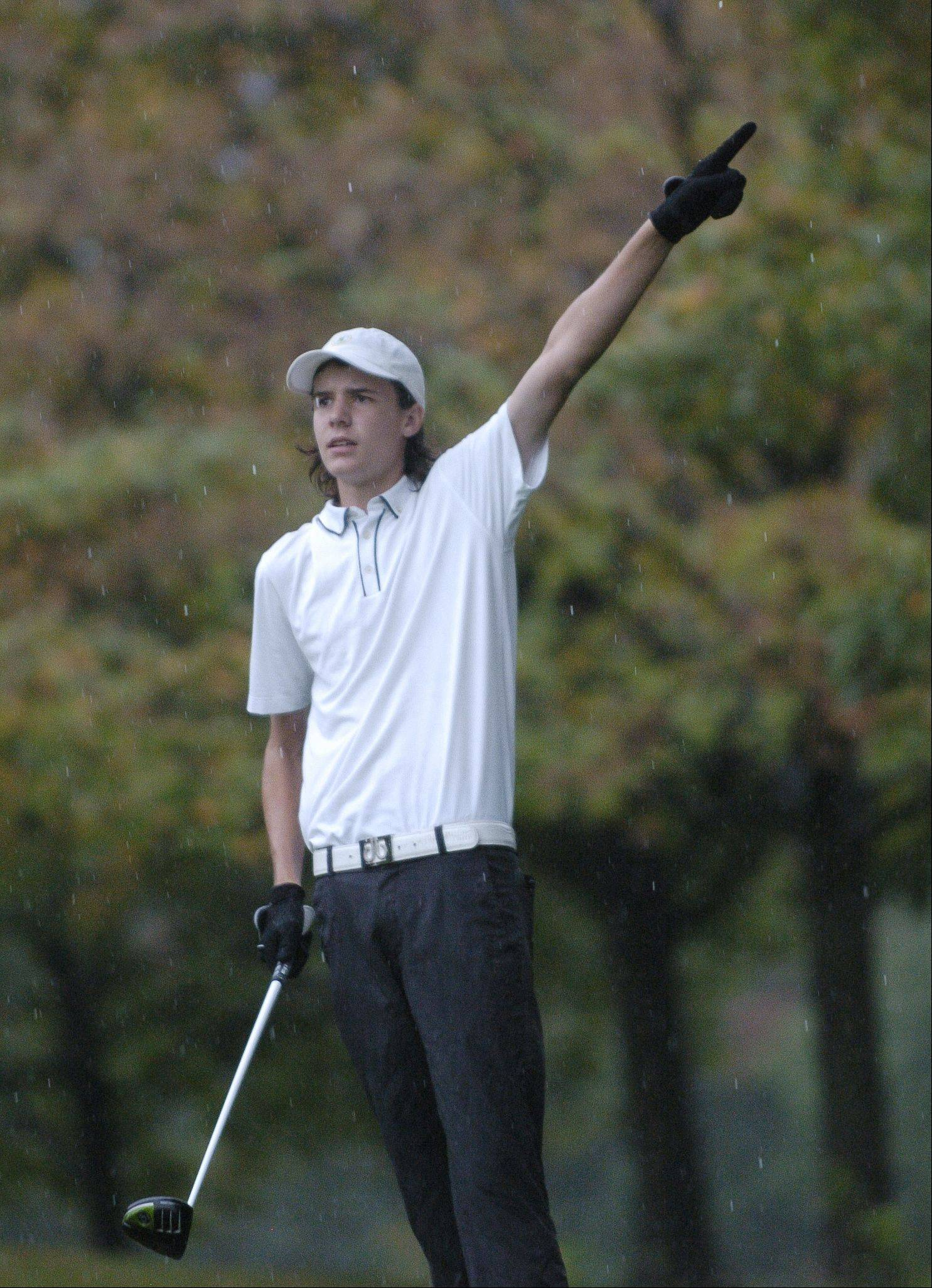 Wheaton Warrenville South's Will Kelly wants his fourth hole tee shot to go left. Rain briefly halted play in Bartlett Thursday at a DuPage Valley Conference boys golf tournament at Bartlett Hills Golf course.