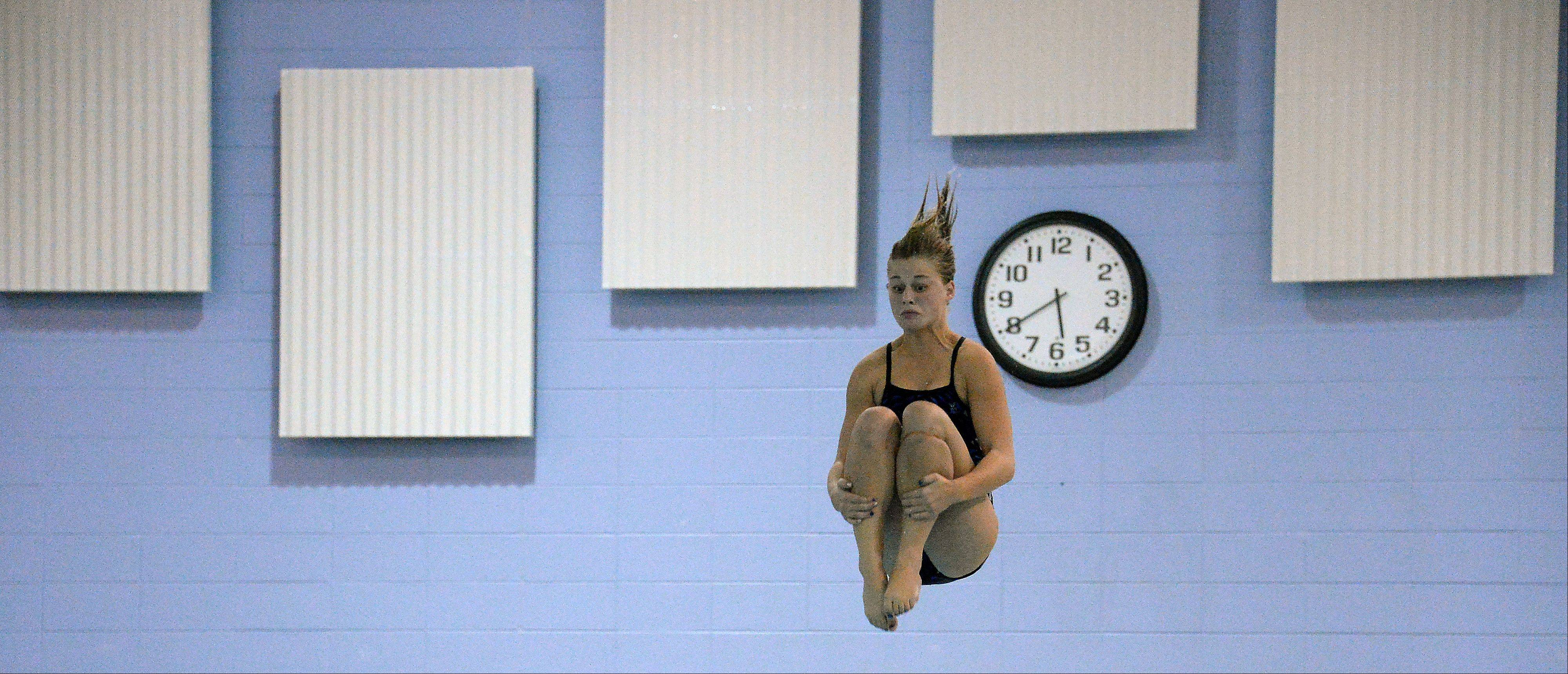 Prospect's Dana Liva soars to victory against Hersey at Olympic Pool in Arlington Heights on Thursday.