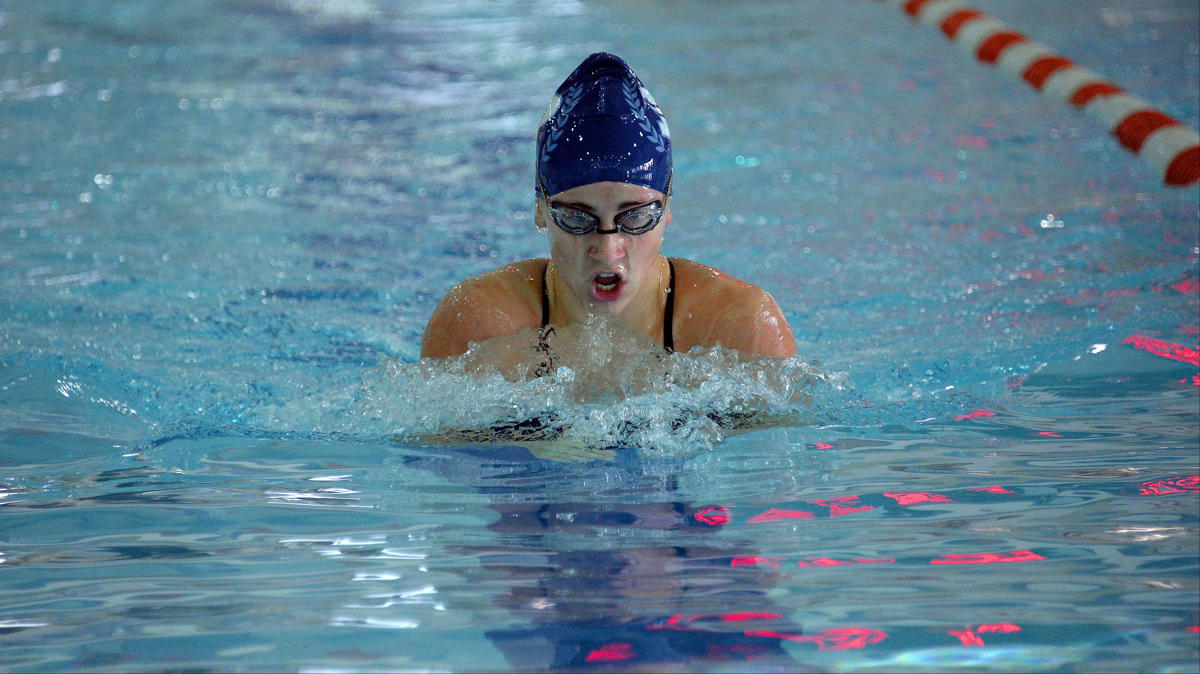 Prospect's Rachel Rozow is victorious in lane four as she leads a 1-2-3 Knights effort in 200-yard IM against host Hersey on Thursday.