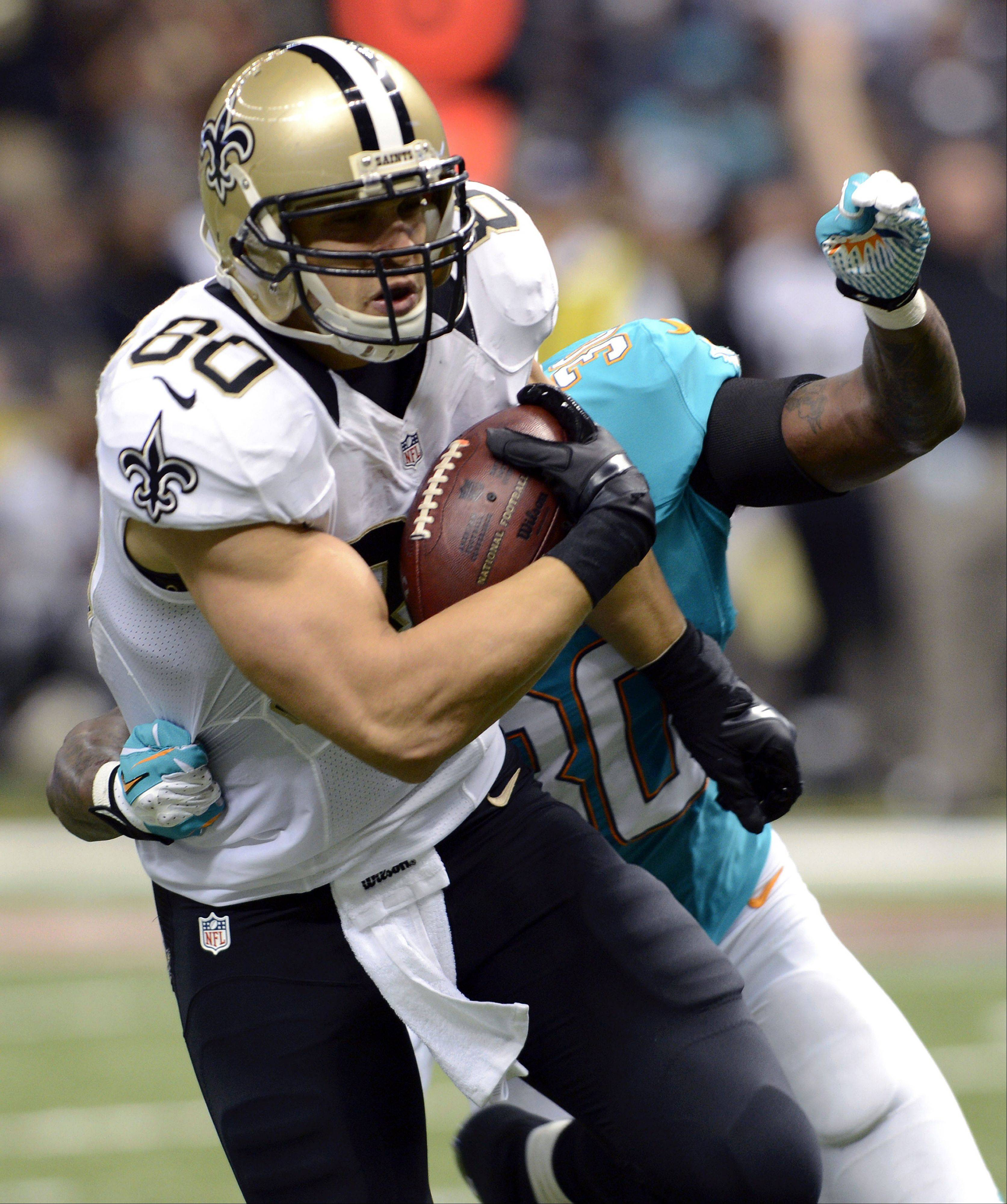 Saints tight end Jimmy Graham leads the NFL with 6 TD catches and is second with 458 receiving yards.