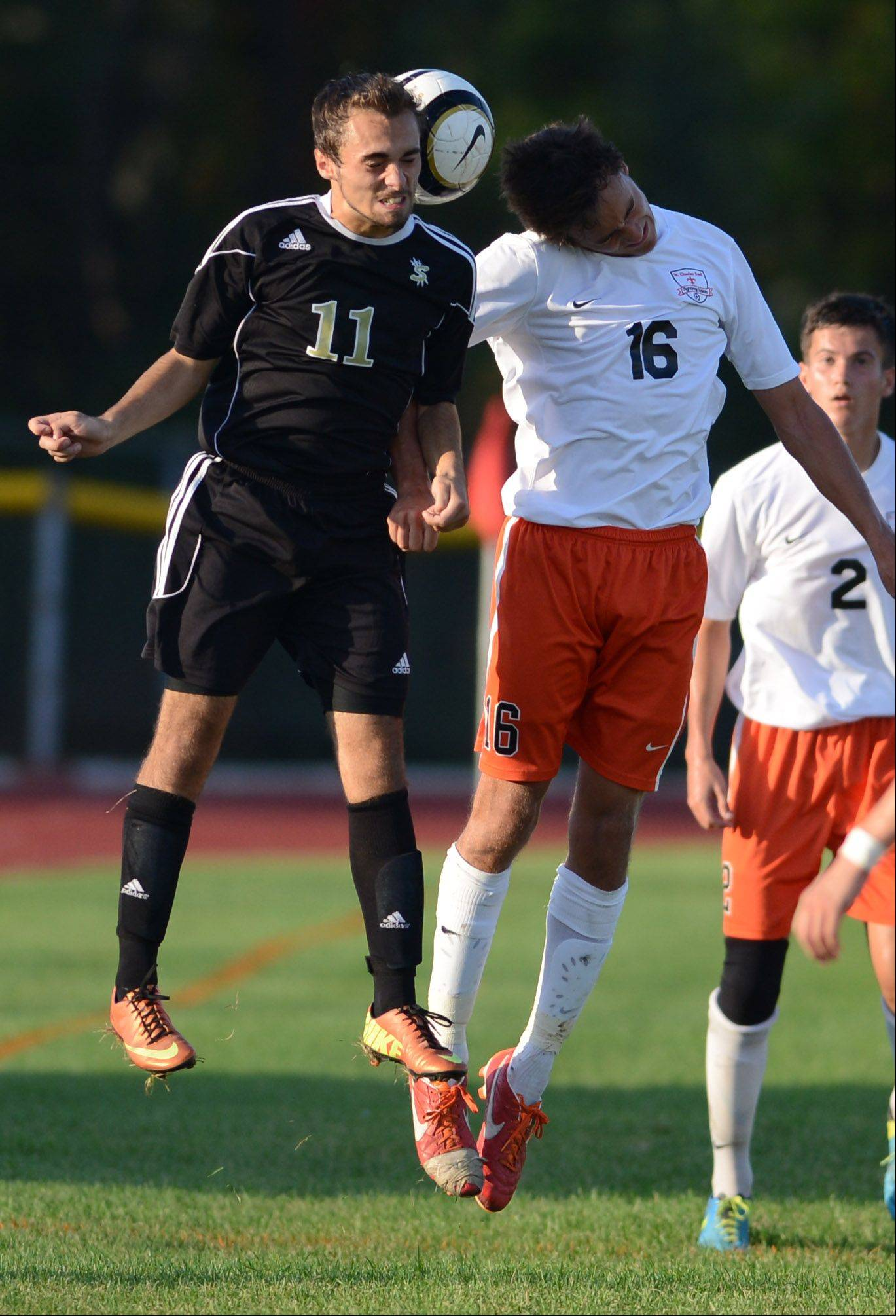Streamwood's Brandon Malpartida and St. Charles East's Jordan Moore battle for a header during Thursday's game in St. Charles.