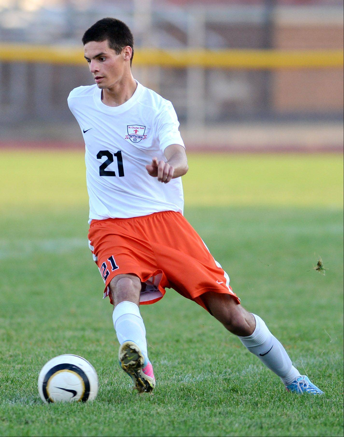 St. Charles East's Daniel DiLeonardi controls the ball in the midfield during Thursday's game in St. Charles.