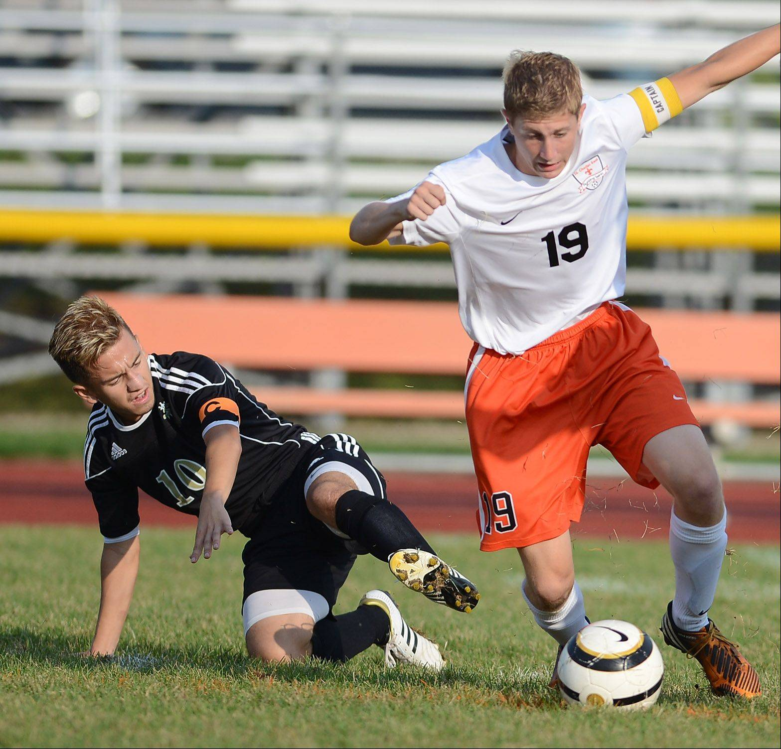 St. Charles East's Andrew Shone gets past Streamwood's Nestor Ascencio during Thursday's game in St. Charles.