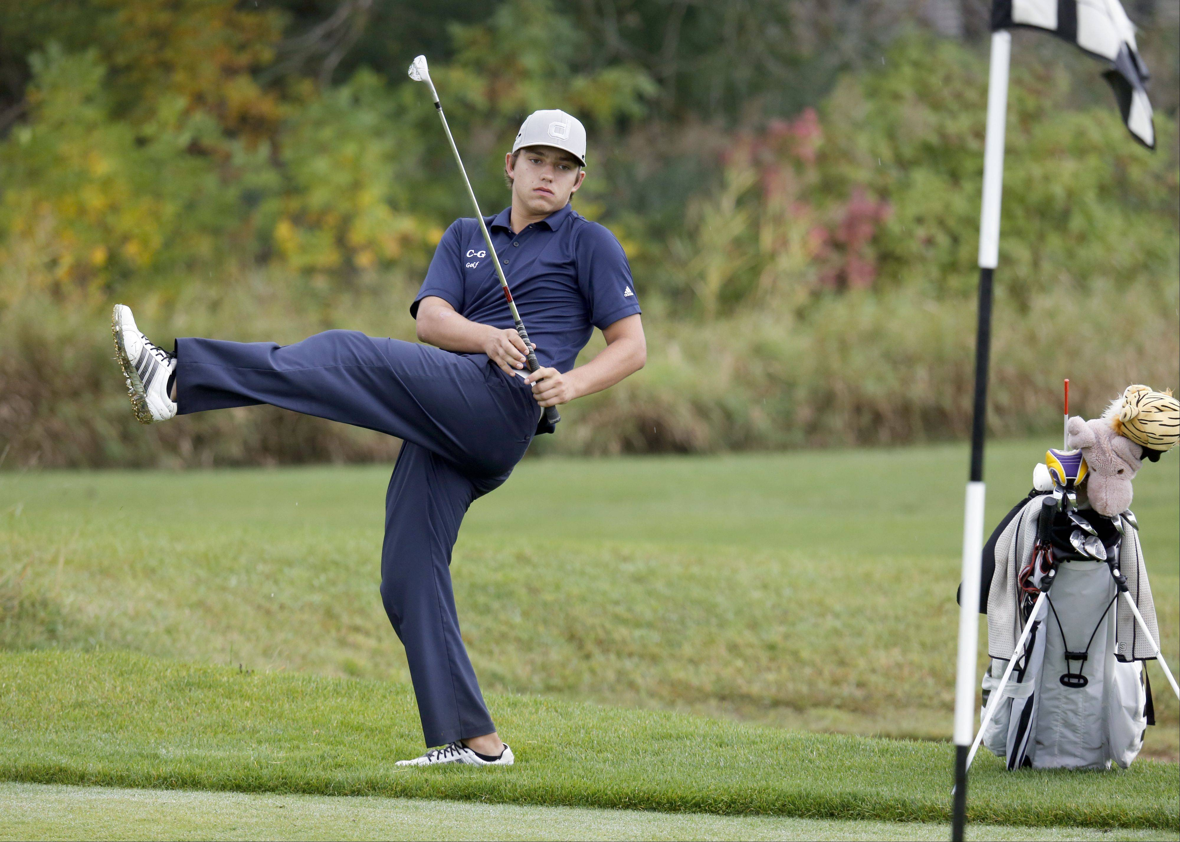 Cary Grove's Daniel DePrey reacts to his chip on the 5th green during the Fox Valley Conference boys golf tournament at the Golf Club of Illinois Thursday in Algonquin.