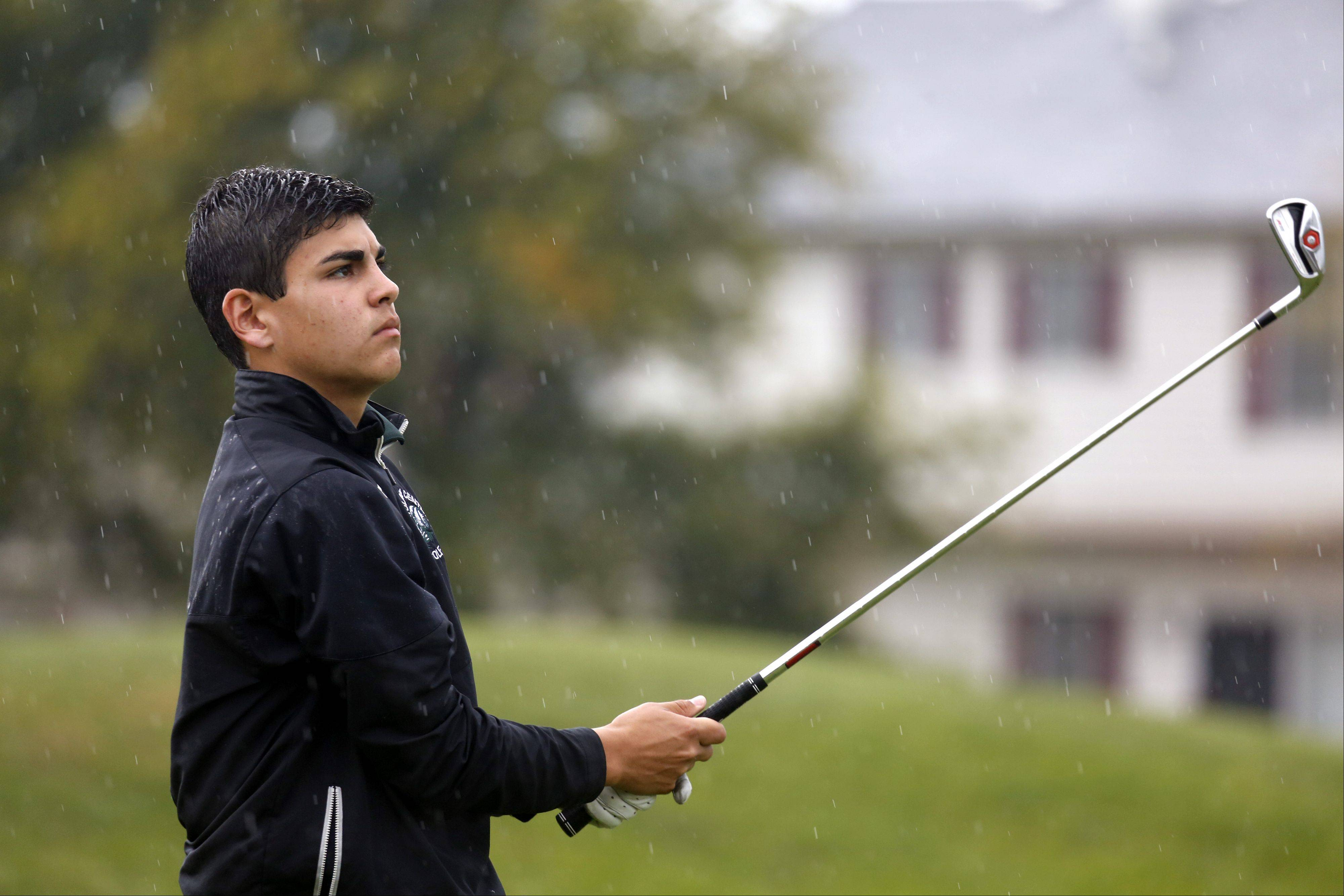 Grayslake Central's Kyle Reynolds watches his shot on the 17th tee during the Fox Valley Conference boys golf tournament at the Golf Club of Illinois Thursday in Algonquin.