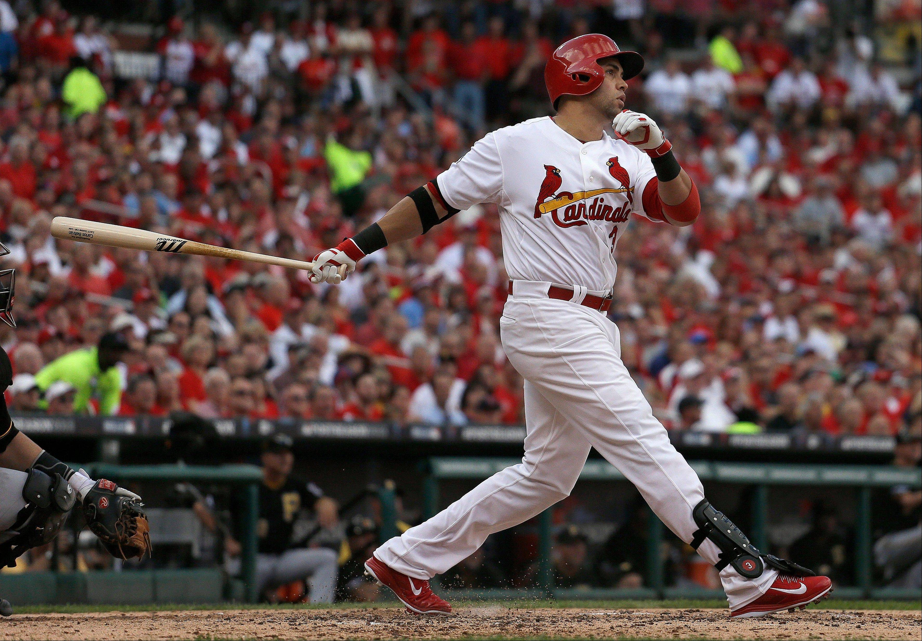 St. Louis Cardinals' Carlos Beltran follows through on a three-run home run against the Pittsburgh Pirates in the third inning of Game 1 of baseball's National League division series, Thursday, Oct. 3, 2013, in St. Louis.