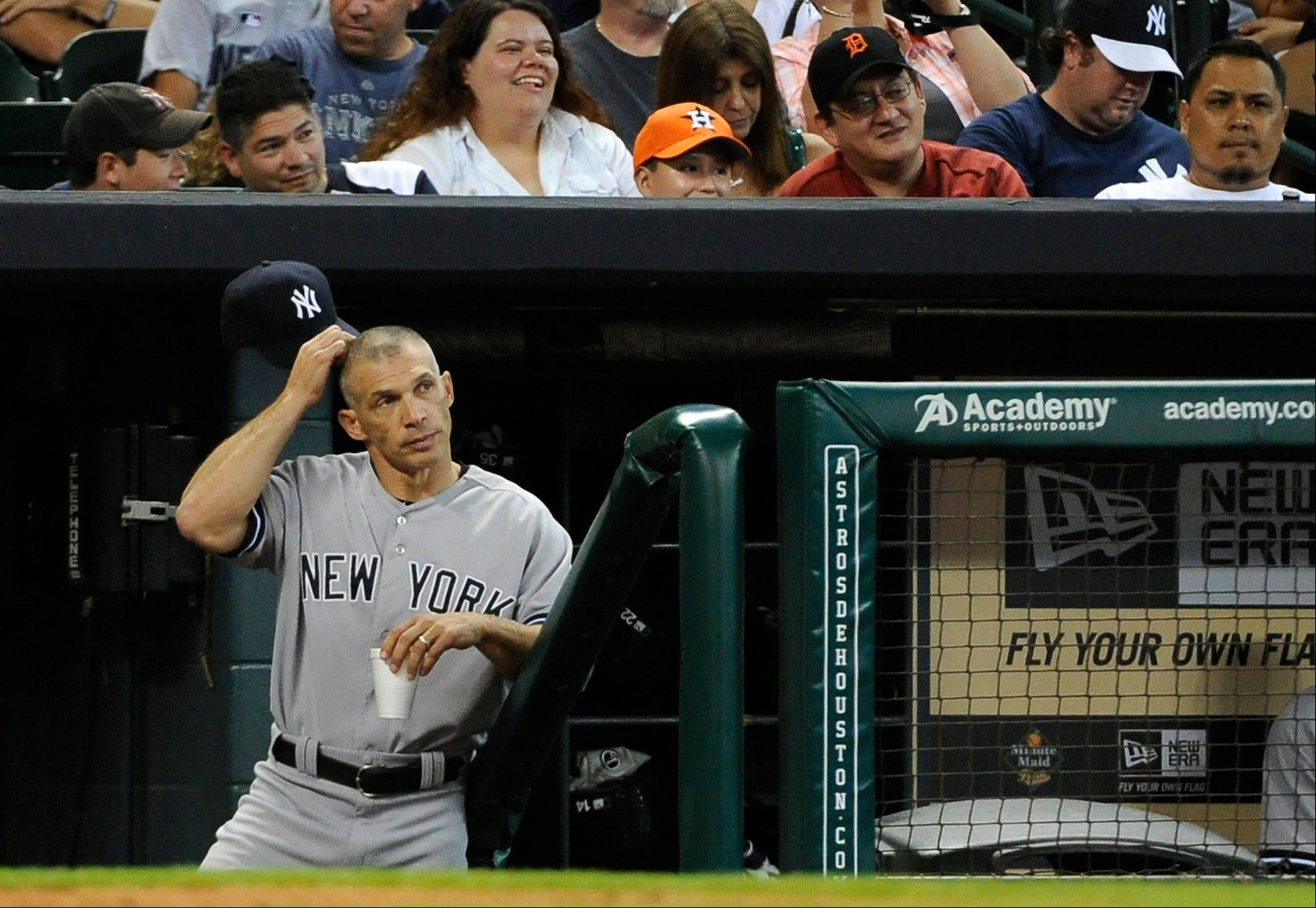 Associated PressAccording to a New York report, the Yankees will not allow the Cubs to talk with manager Joe Girardi while he remains under contract. Girardi's contract expires Nov. 1, but GM Brian Cashman says he wants Girardi to stay.