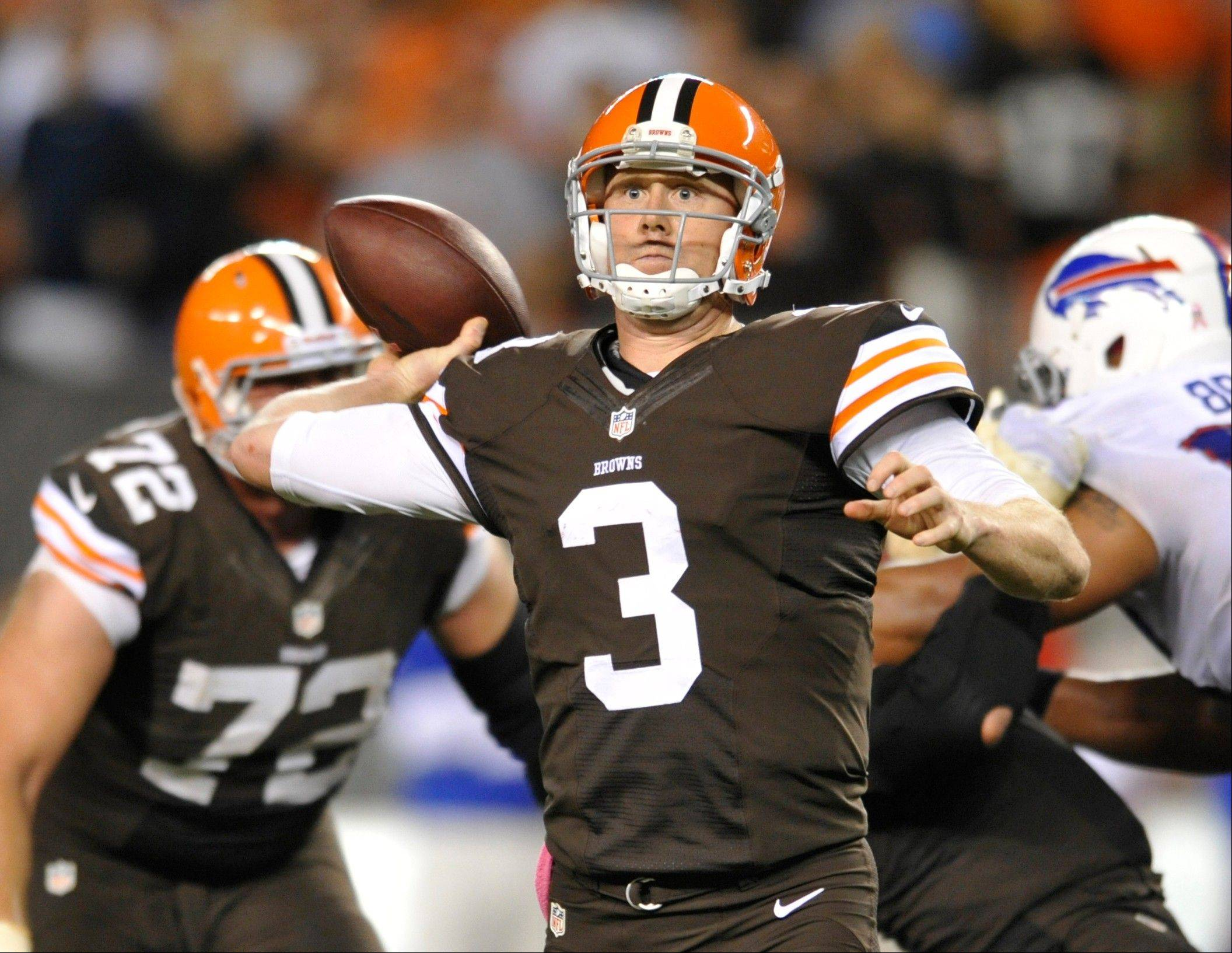 Cleveland Browns quarterback Brandon Weeden passes against the Buffalo Bills in the fourth quarter of an NFL football game Thursday, Oct. 3, 2013, in Cleveland. Weeden took over for starter Brian Hoyer who was injured in the first quarter.