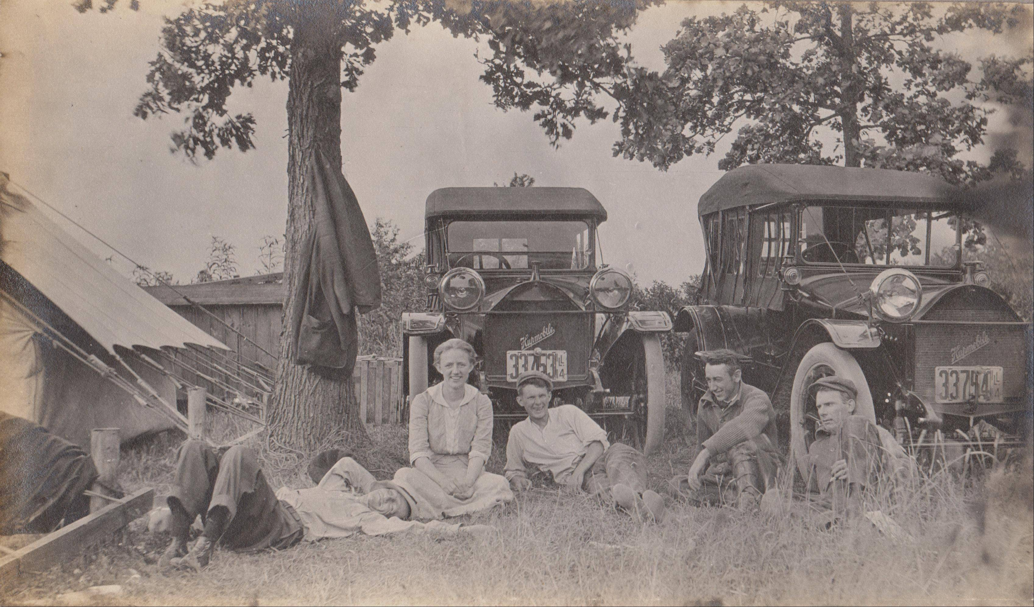 The Miller family of Union take a break during a motor camping trip in 1914. Travelers would bring their own camping gear as there weren't many hotels located along roadways.