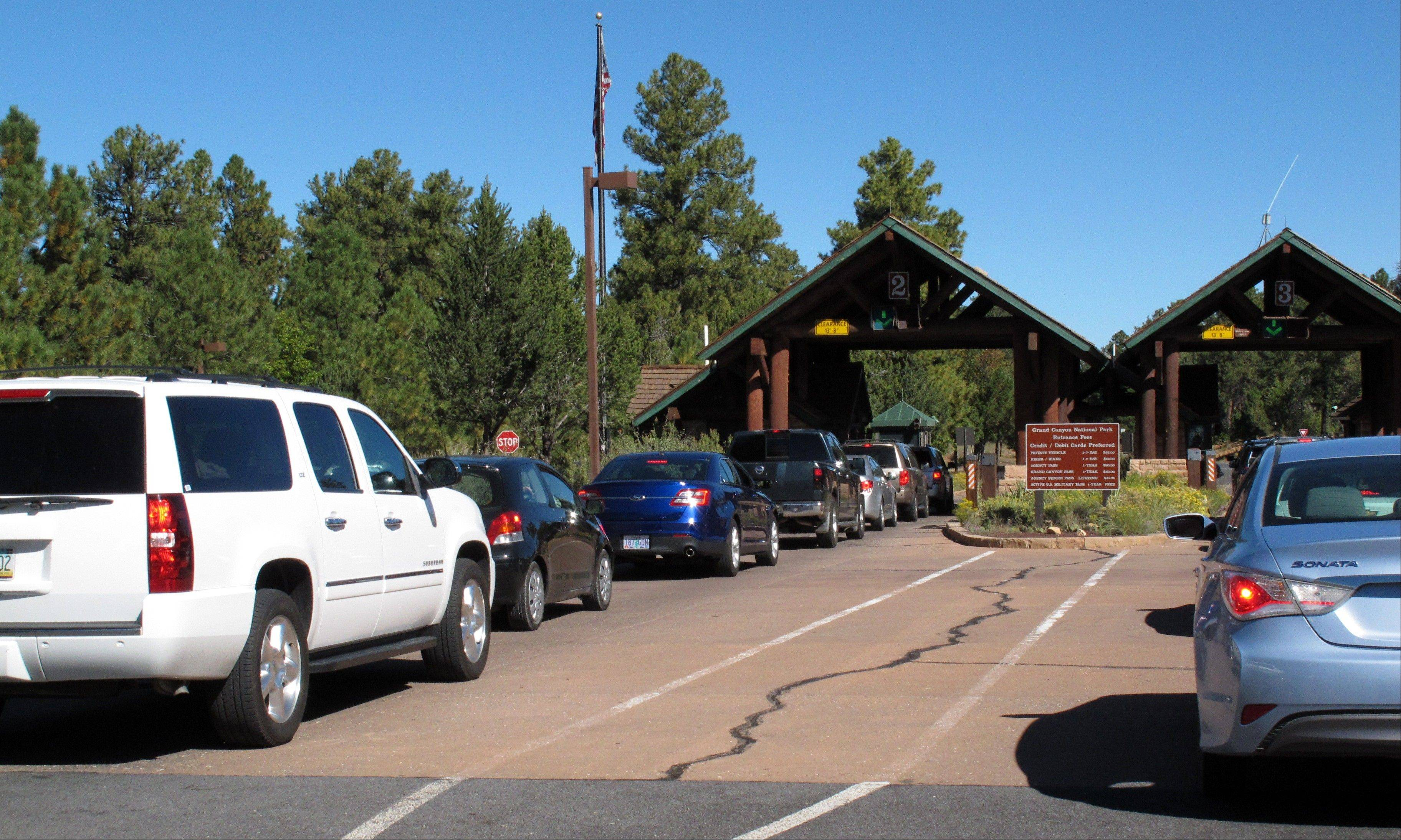 Cars line up at Grand Canyon National Park�s South Rim entrance on Monday.