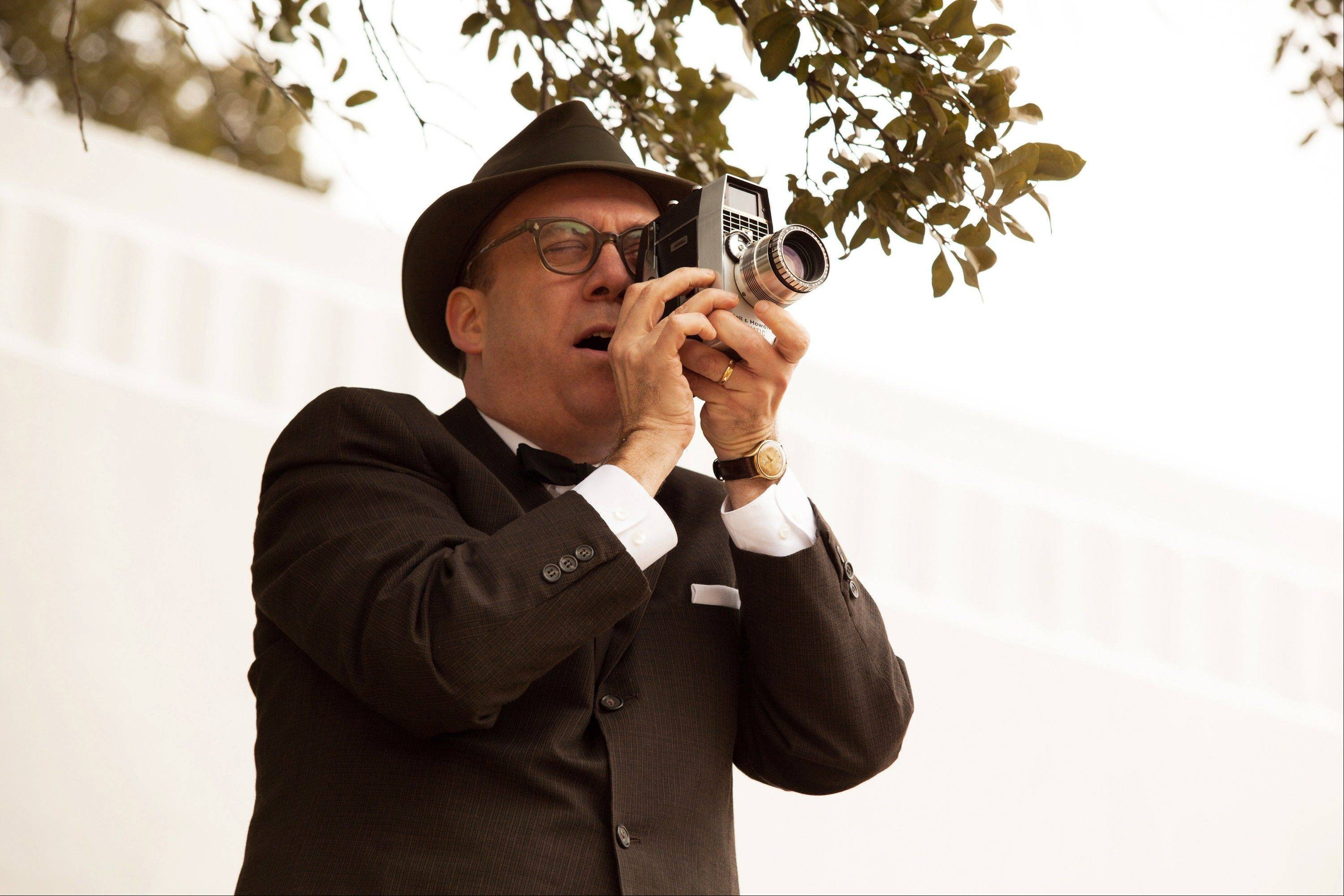 "Paul Giamatti plays the unlikely documentarian Abraham Zapruder in ""Parkland,"" which is in theaters now, just before the 50th anniversary of the Nov. 22, 1963, assassination of President Kennedy. The film recounts the chaotic events that occurred in and around the eponymous hospital after the president was brought there with hopes of saving his life."