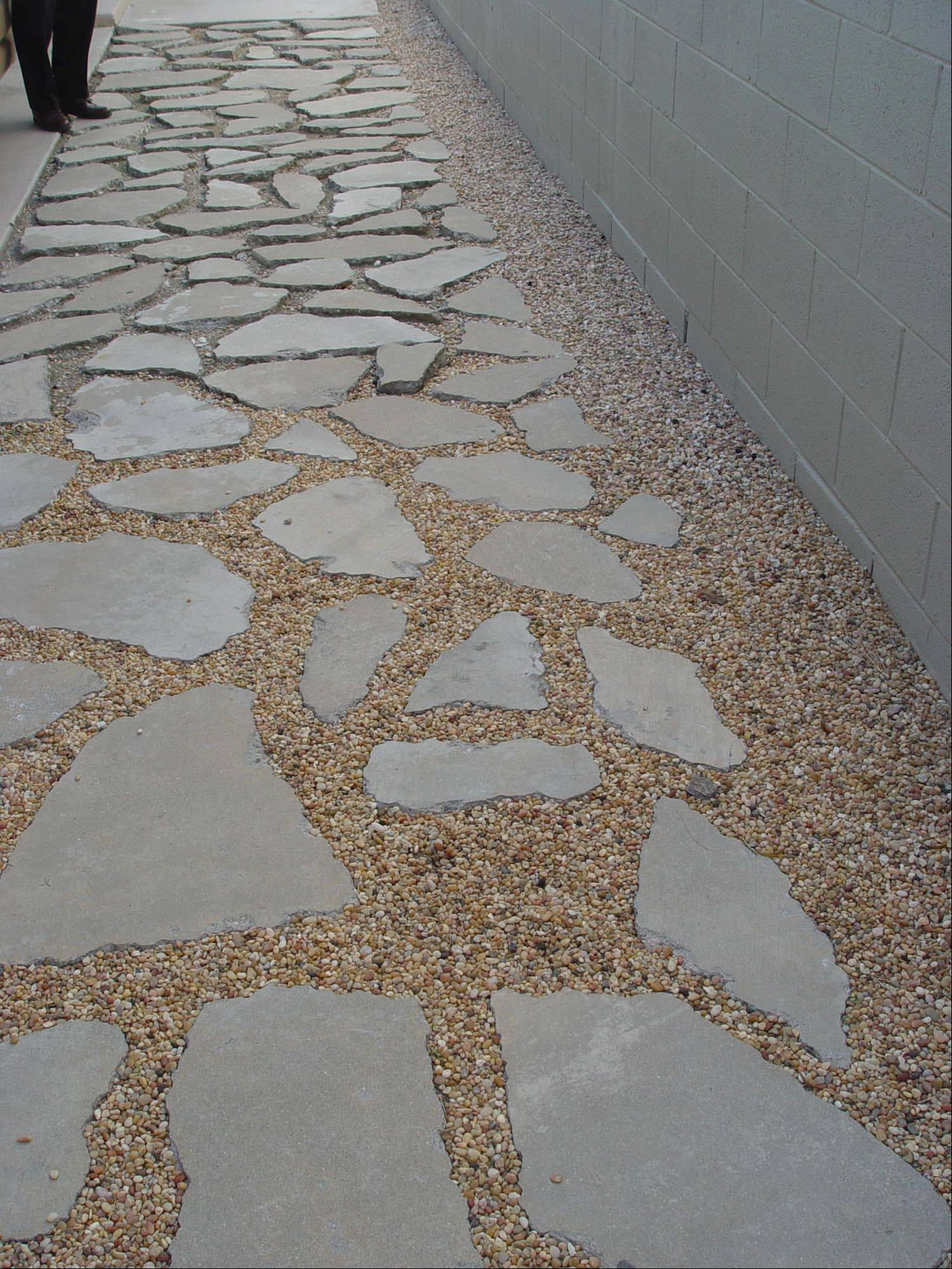 Very fine rounded pebbles are easy on bare feet whether or not you add concrete fragment flagstones.