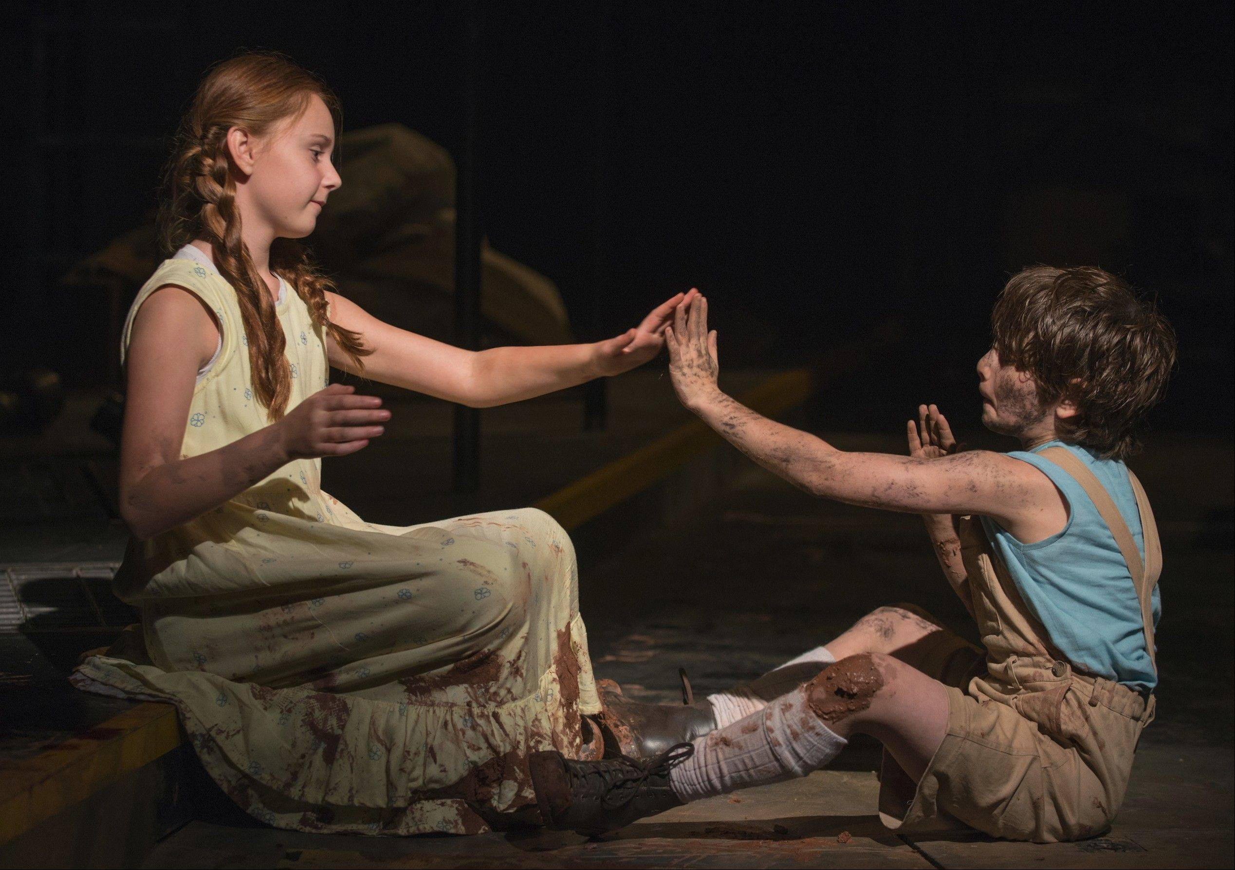 "Emma Gordon plays The Girl opposite Daniel Pass' The Boy in Steppenwolf Theatre's production of ""The Wheel,"" Zinnie Harris' examination of war across the ages."
