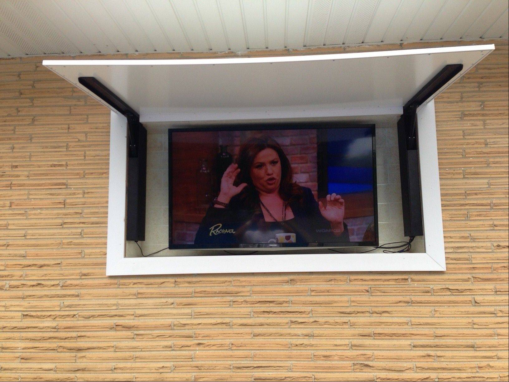A remote-controlled cover allows you to watch TV on your deck or patio.