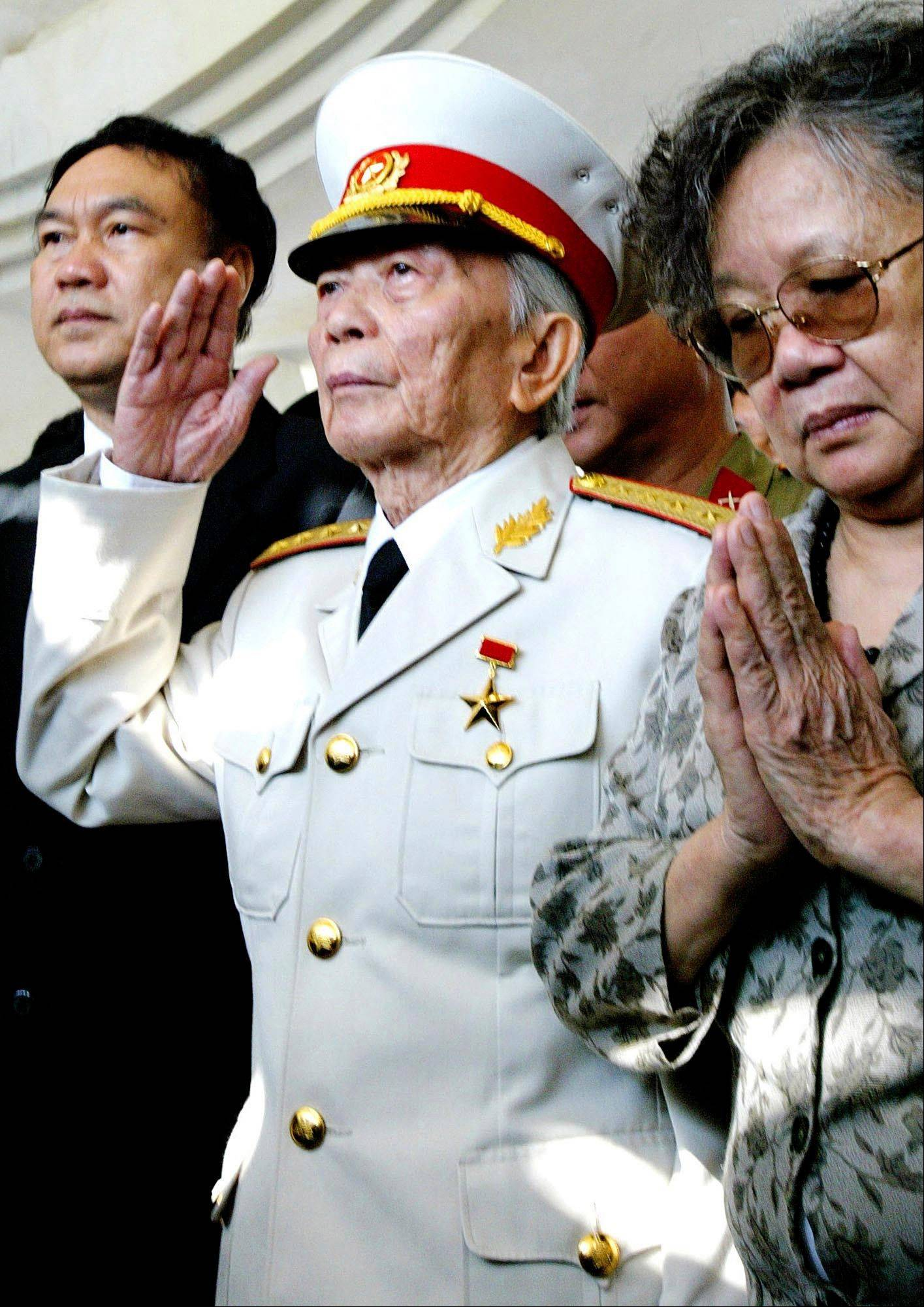 Gen. Vo Nguyen Giap salutes his fallen comrades at a shrine of the Dien Bien Phu�s war cemetery in 2004. Officials say legendary Gen. Giap, the military mastermind who drove the French and the Americans out of Vietnam, died at a Hanoi hospital Friday, Oct. 4, 2013, at age 102. He was the country�s last famous communist revolutionary, and used ingenious guerrilla tactics to overcome enormous odds against superior forces.