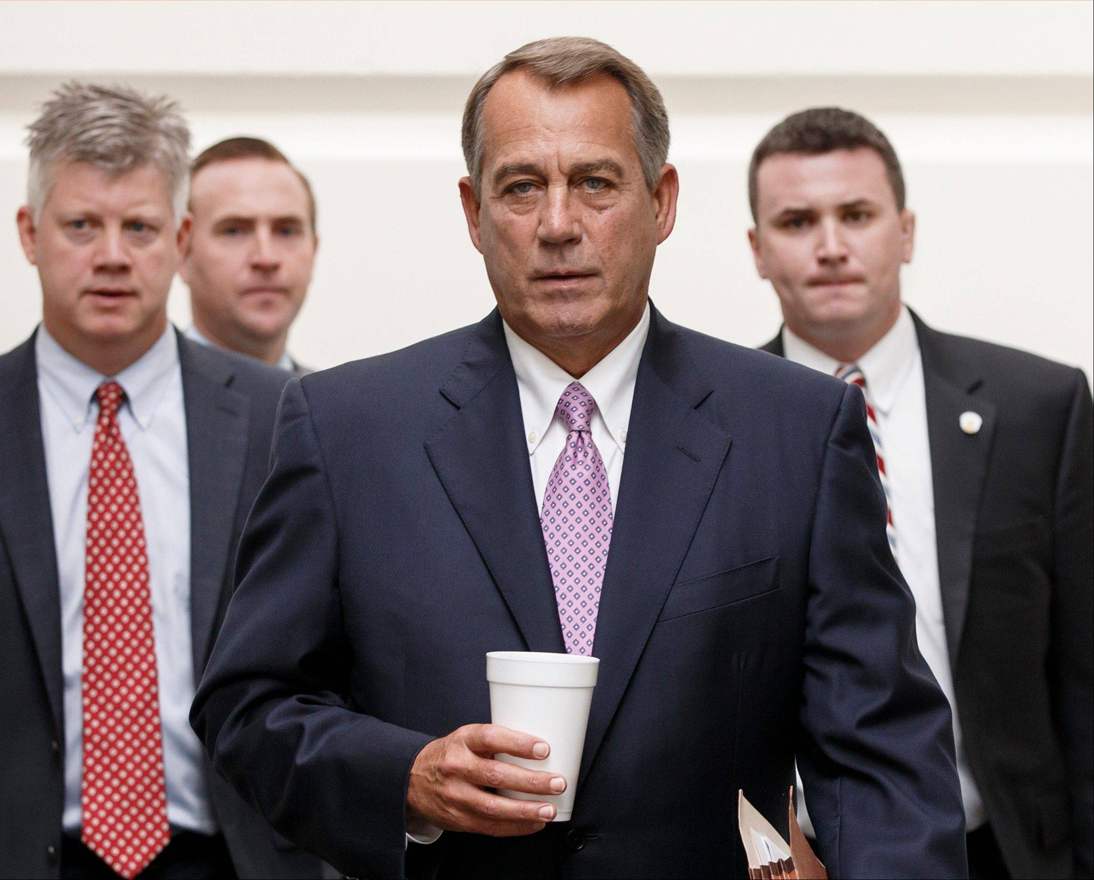 House Speaker John Boehner of Ohio walks to a Republican strategy session on Capitol Hill in Washington, Friday, Oct. 4, 2013. Boehner is struggling between Democrats that control the Senate and GOP conservatives in his caucus who insist any funding legislation must also kill or delay the nation's new health care law. Added pressure came from President Barack Obama who pointedly blamed Boehner on Thursday for keeping federal agencies closed.