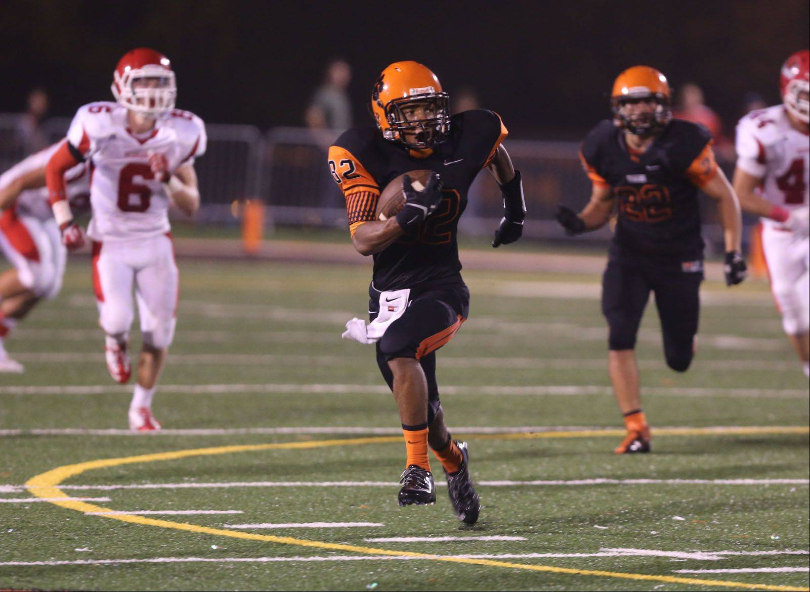 Wheaton Warrenville South�s Keishawn Watson returns a punt against Naperville Central Friday night.