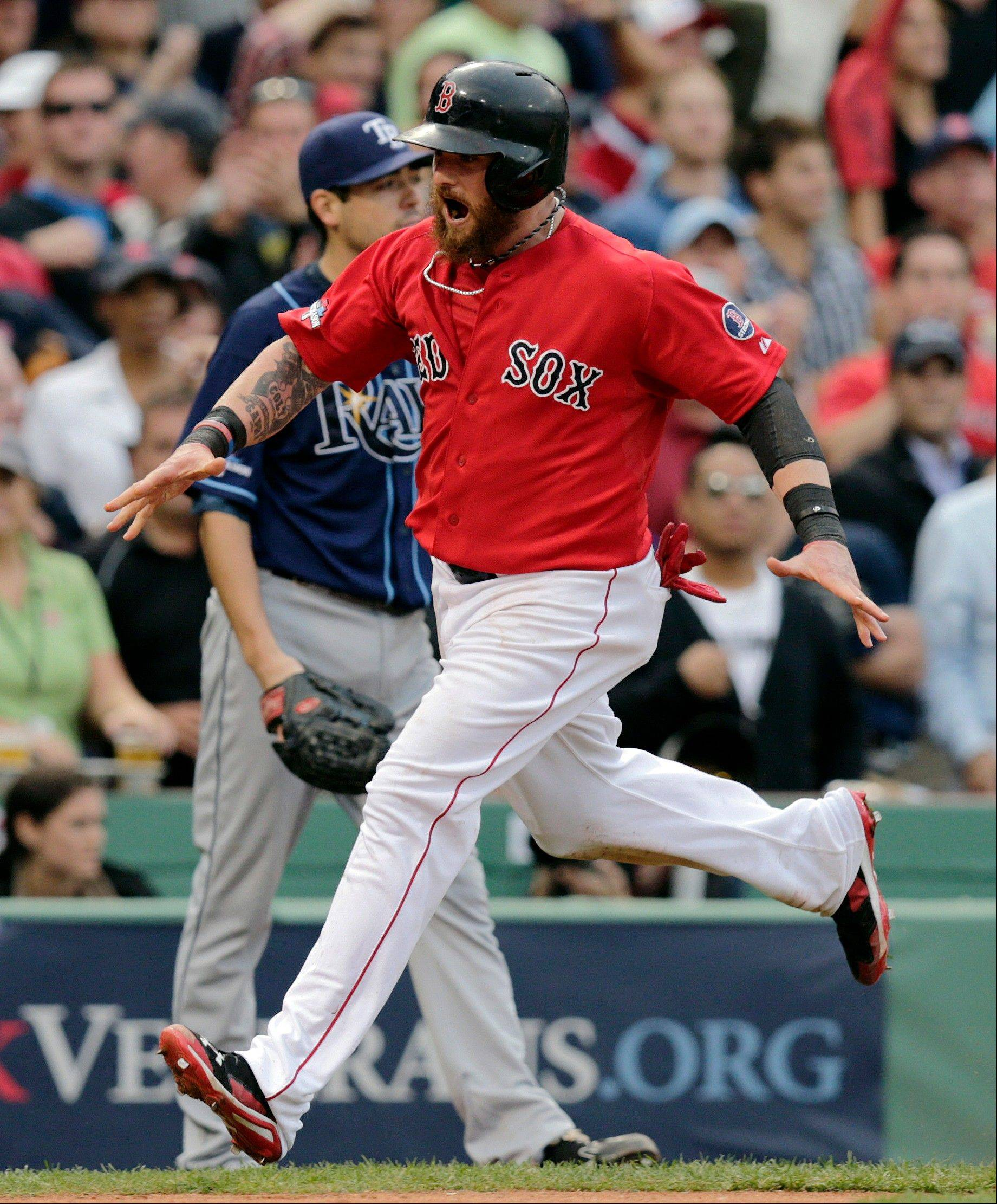 Boston�s Jonny Gomes scores on a double by Jarrod Saltalamacchia in the fifth inning in Game 1 of the American League Division Series against the Tampa Bay Rays on Friday in Boston.