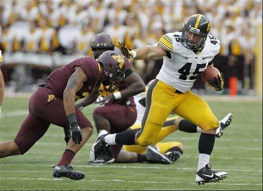 Iowa fullback Mark Weisman leaves behind Minnesota defensive back Cedric Thompson on a 14-yard gain during last week�s road win over the Gophers. Weisman, a Stevenson grad, has epitomized Iowa�s tough-minded personality.