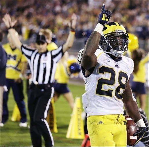 Michigan running back Fitzgerald Toussaint celebrates after his fourth-quarter touchdown against Connecticut in a Sept. 21 game in East Hartford, Conn. Michigan won 24-21.
