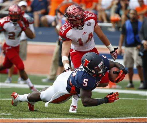 Illinois running back Donovonn Young leaps into the end zone in front of Miami (Ohio) defensive back Jay Mastinduring the first half of last Saturday�s win in Champaign.