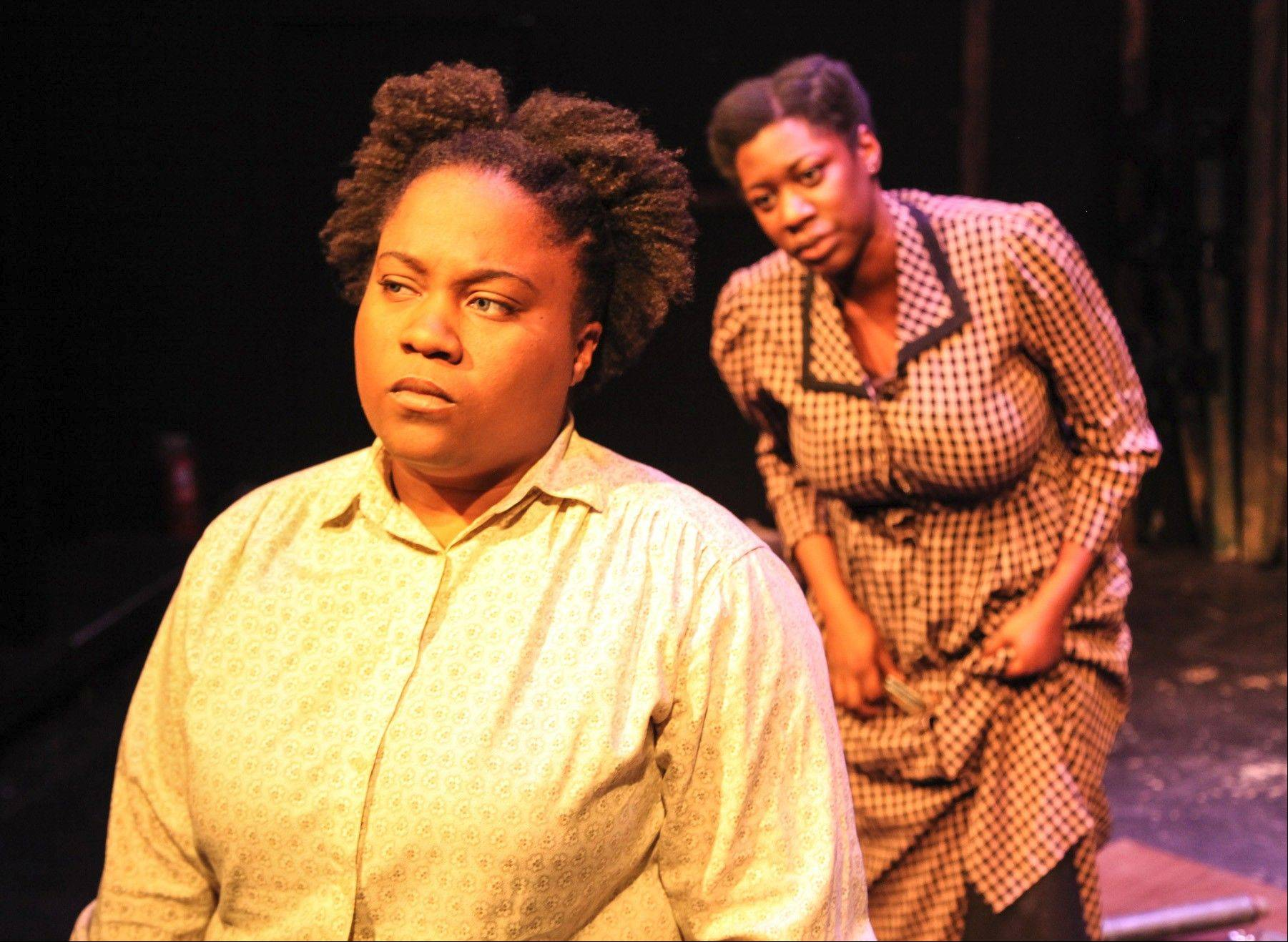 "BrittneyLove Smith, left, plays civil rights activist Ida B. Wells in Theatre Seven of Chicago's ""Unwilling and Hostile Instruments: 100 Years of Extraordinary Chicago Women,"" which also features Echaka Agba."