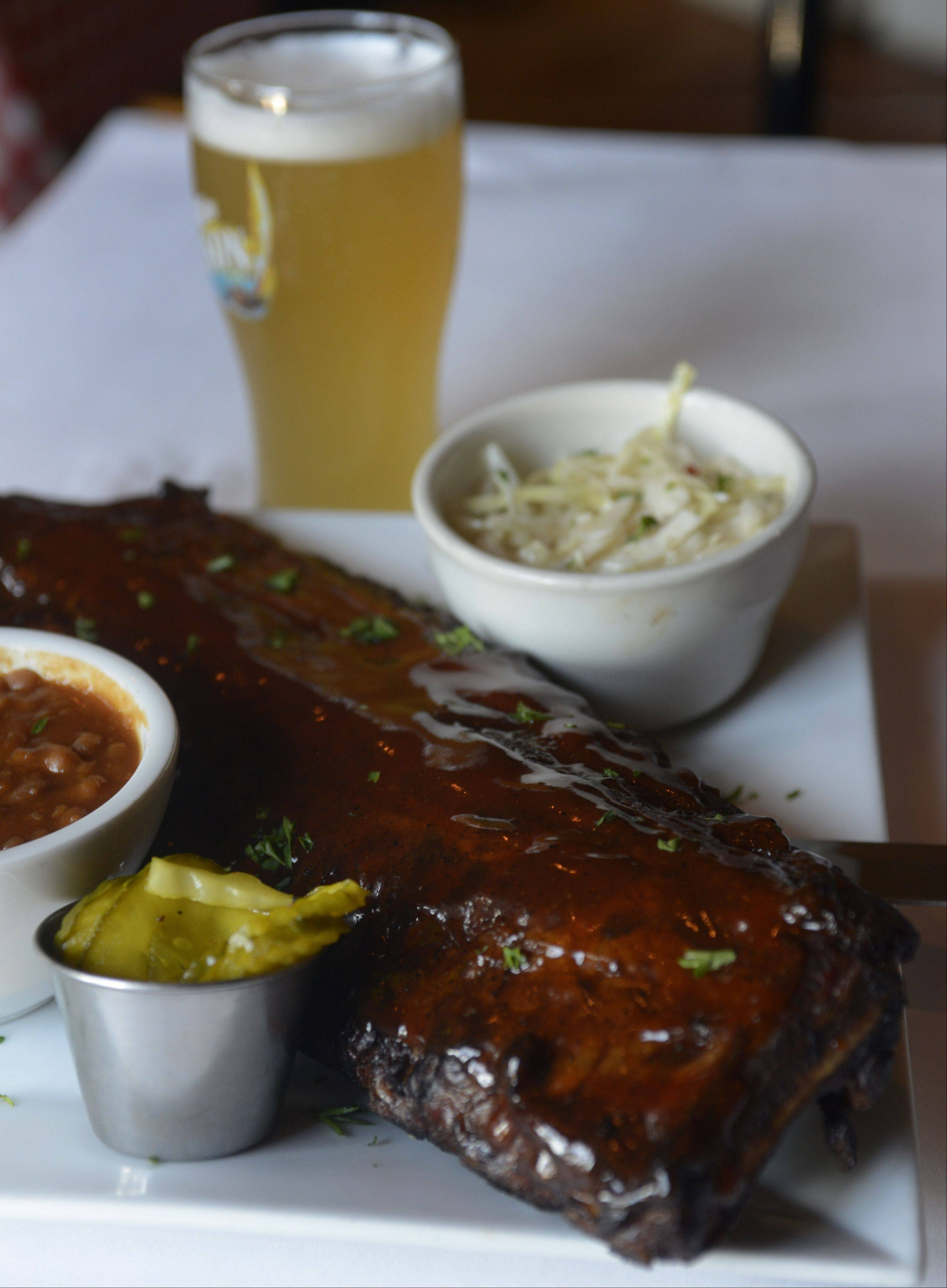 Baby back ribs pair perfectly with coleslaw and a cold brew at Gugg's Roadhouse in Vernon Hills.