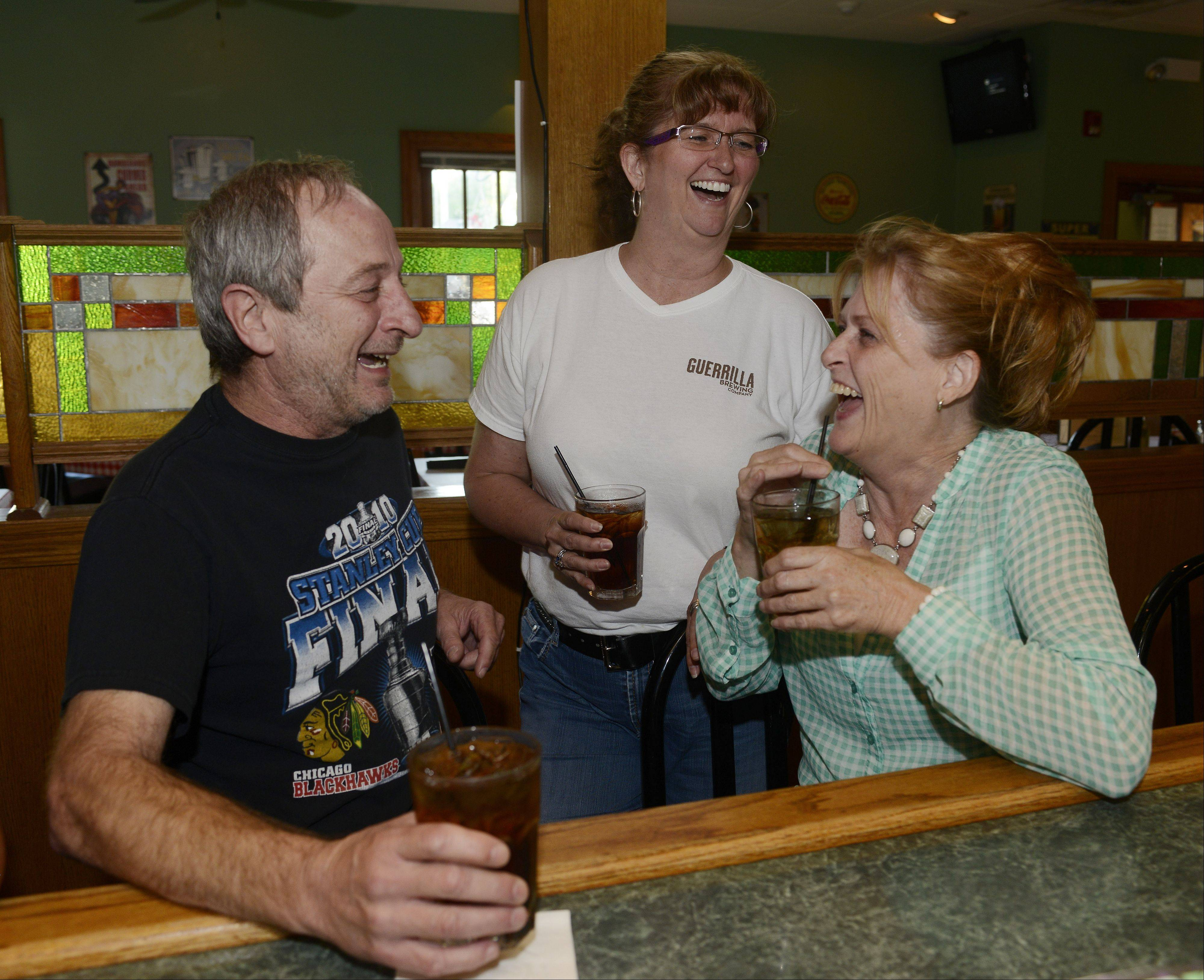 Dave Brandt, left, Kelly Russell and Tammy Beltran, all of Mundelein, enjoy themselves at Gugg's Roadhouse in Vernon Hills.
