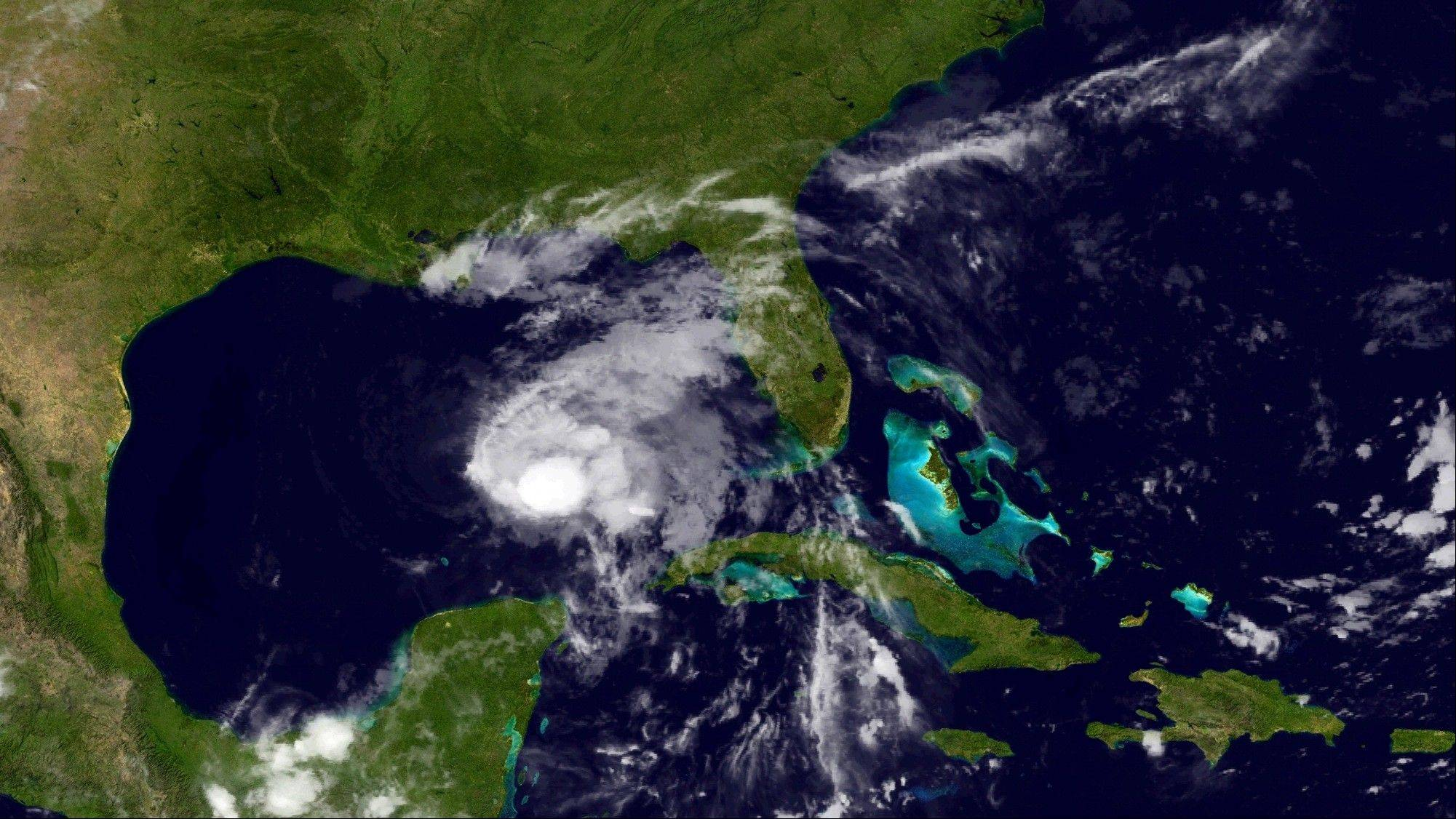 This image provided by NOAA shows Tropical Storm Karen taken late Thursday night Oct. 3, 2013. The National Hurricane Center in Miami said late Thursday that Karen was about 340 miles (547 kilometers) south of the mouth of the Mississippi River and had maximum sustained winds of 65 mph (100 kph) with higher gusts.