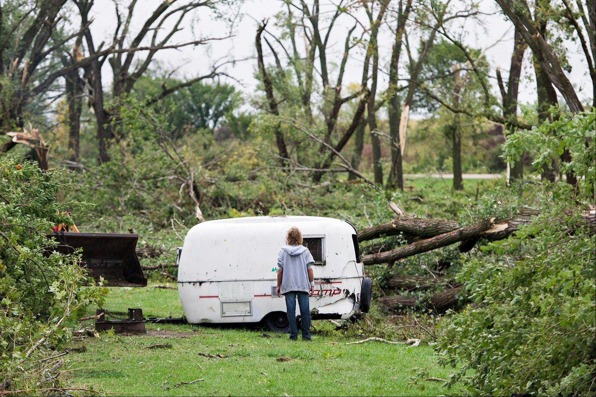 Jim Stoddard watches as his travel trailer is pulled from a ditch at the Wagon Train Lake campground on Friday, Oct. 4, 2013 in Hickman, Neb. Powerful storms crawled into the Midwest on Friday, dumping heavy snow in South Dakota, spawning a tornado in Nebraska and threatening dangerous thunderstorms from Oklahoma to Wisconsin.