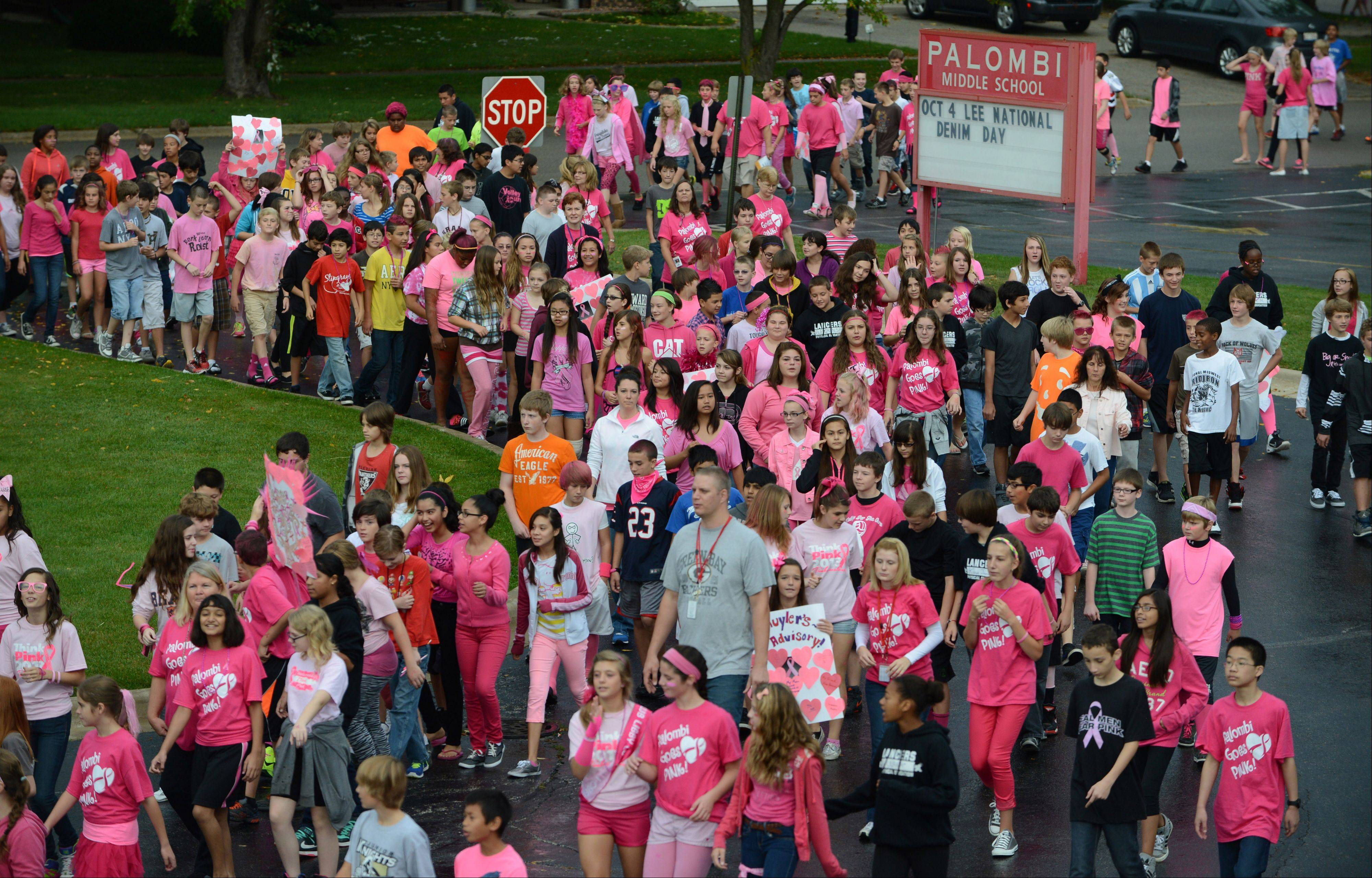 Around 750 seventh and eighth grade Palombi Middle School students participate in the school's annual Breast Cancer Awareness Walk in Lake Villa on Friday. Students and staff raised around $900 for cancer research.