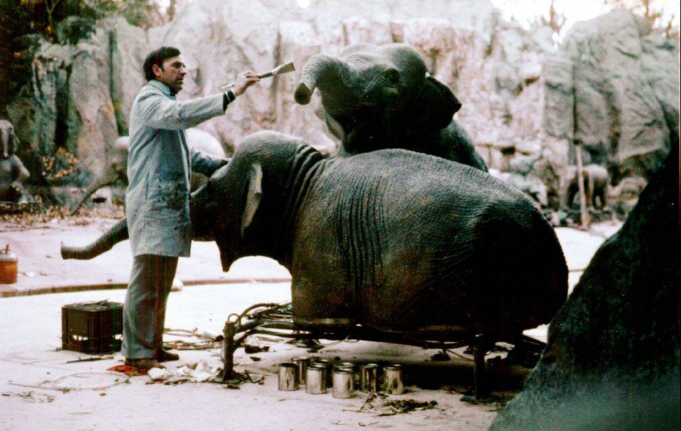 R.J. Ogren works on some elephants in an exhibit while working as a management artist at Disney World.
