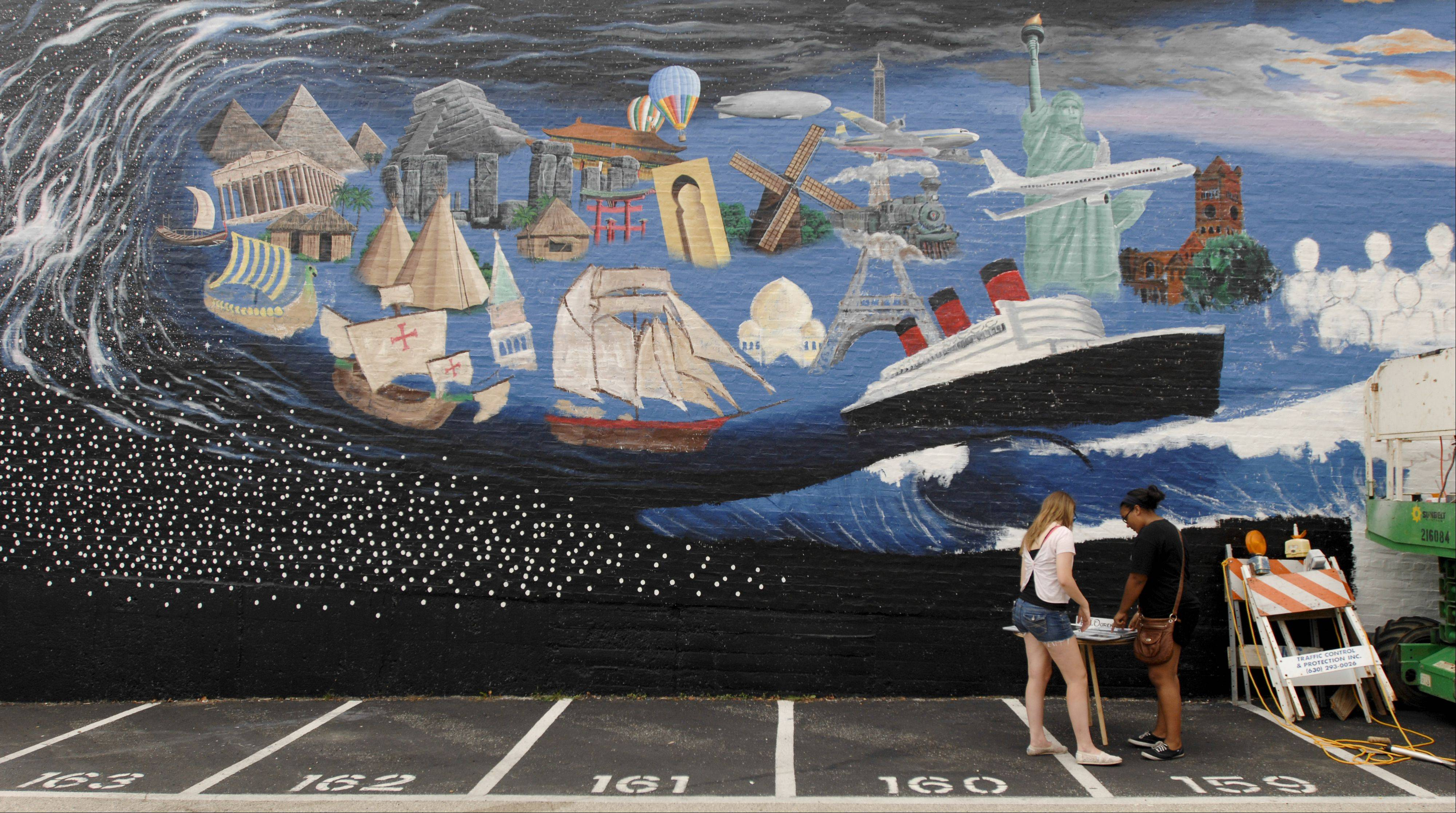 "Wheaton residents and others are invited to sign a star on the mural ""Pearls of the Universe."" The mural celebrates the immigrant journey to Wheaton."