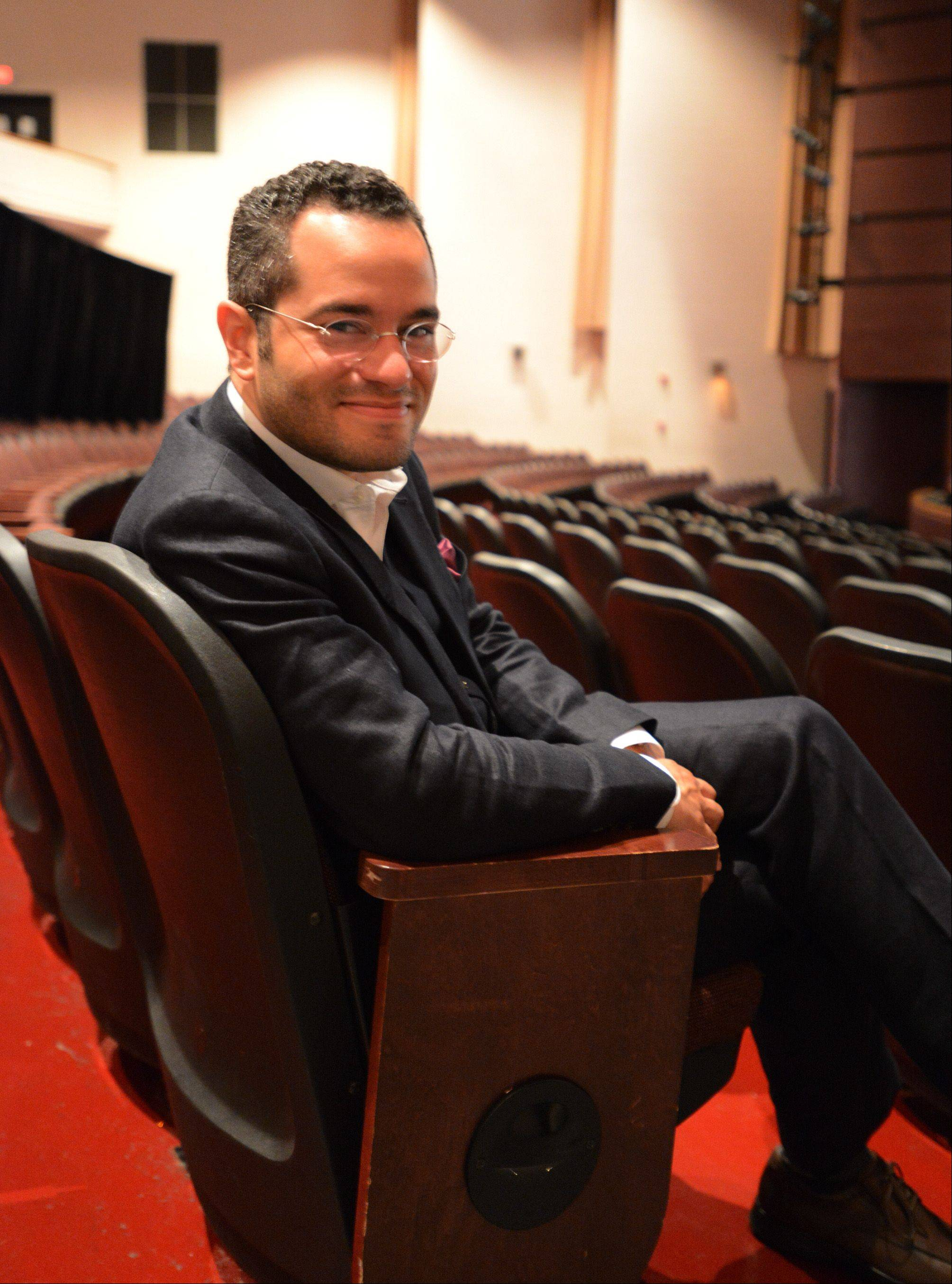 Andrew Grams, pictured in the auditorium of the Hemmens Cultural Center in Elgin, makes his debut as the new conductor for the Elgin Symphony Orchestra on Saturday night.