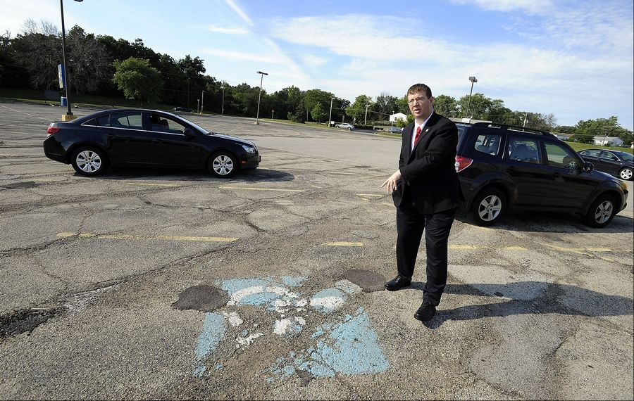 Streamwood resident Andrew Straw points out a poorly displayed handicapped parking spot. Straw recently sent demand letters to several businesses that are in violation of the Americans with Disabilities Act. Disabled rights advocates say while Straw's approach may not win him friends in the business community, what he's doing is not illegal.