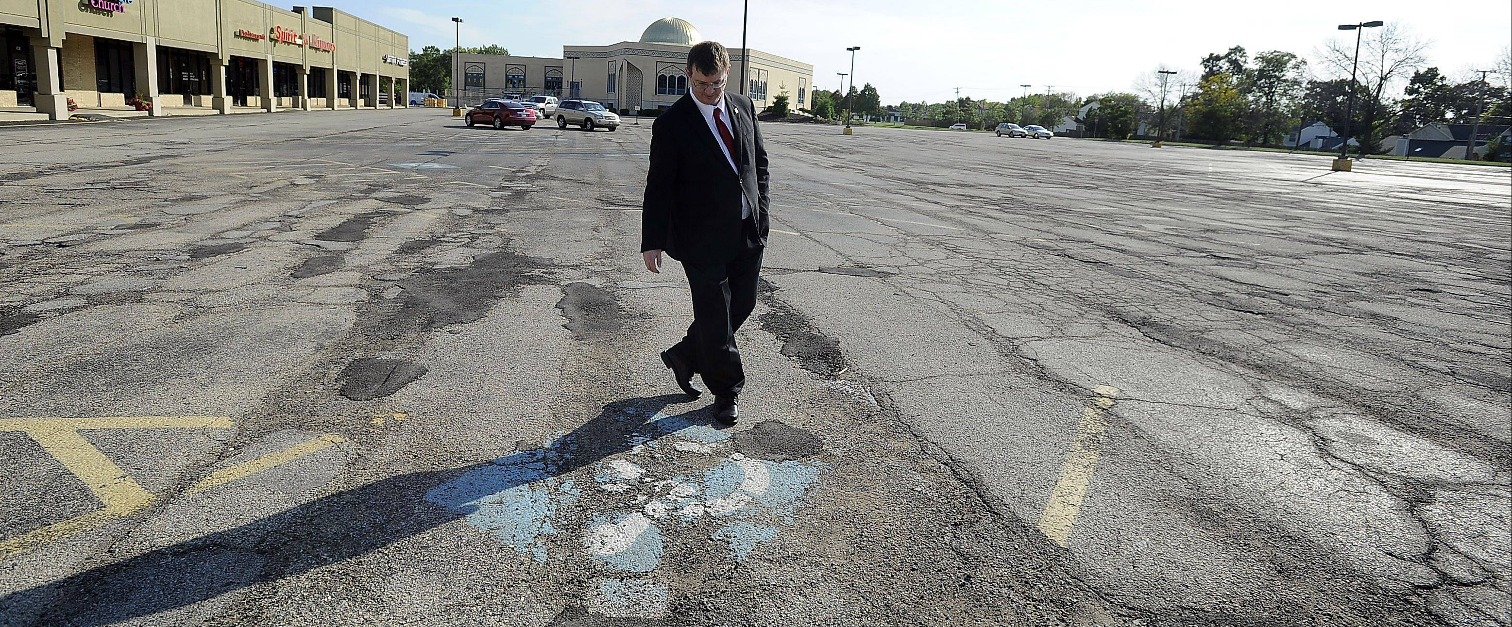 Streamwood resident Andrew Straw points out a poorly displayed handicapped parking spot. Straw recently sent demand letters to several businesses that are in violation of the Americans with Disabilities Act.