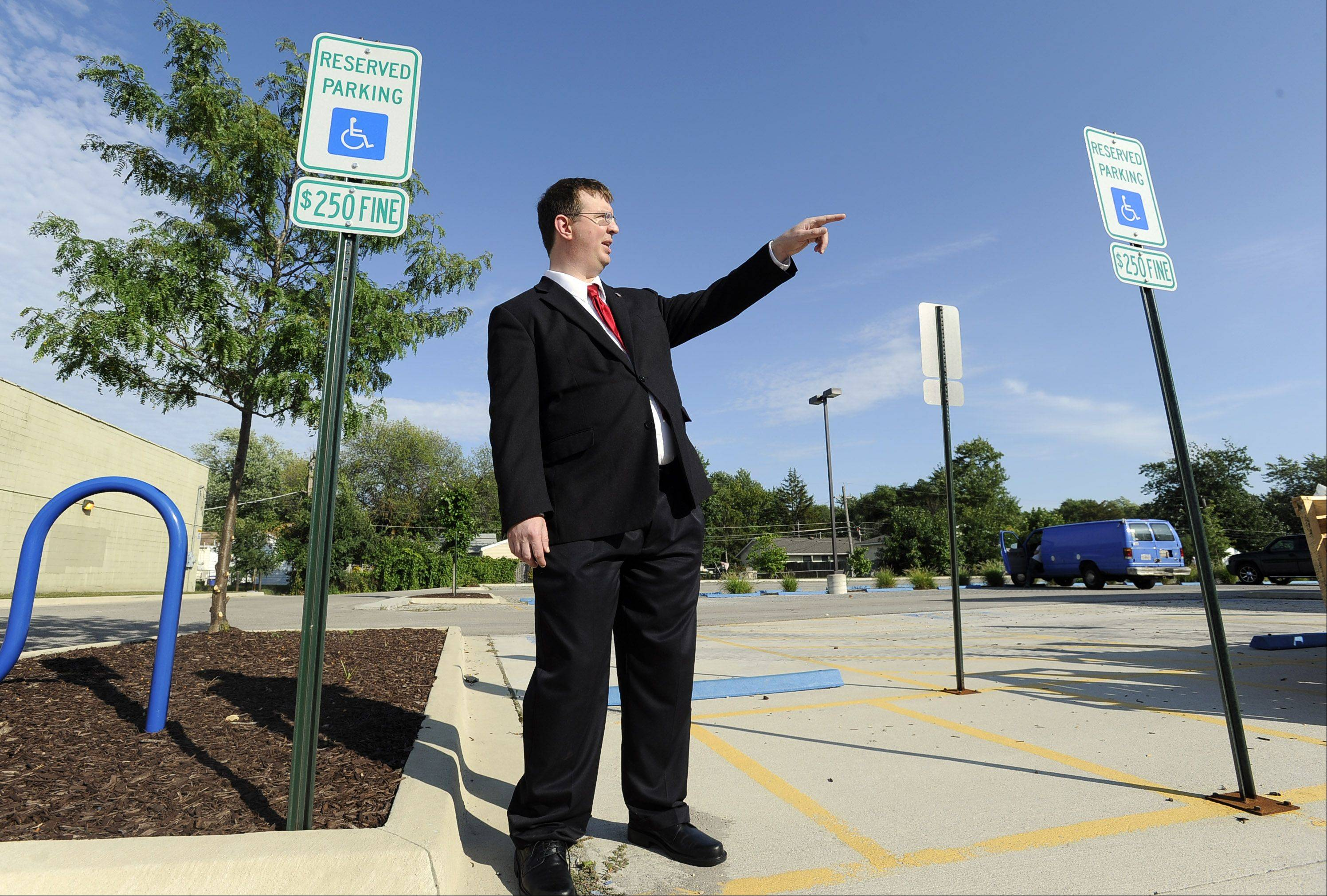 Streamwood resident Andrew Straw points out well-marked handicapped parking. Straw recently sent letters to several businesses that are in violation of the Americans with Disabilities Act demanding they make changes and pay him an out-of-court settlement or face a lawsuit.