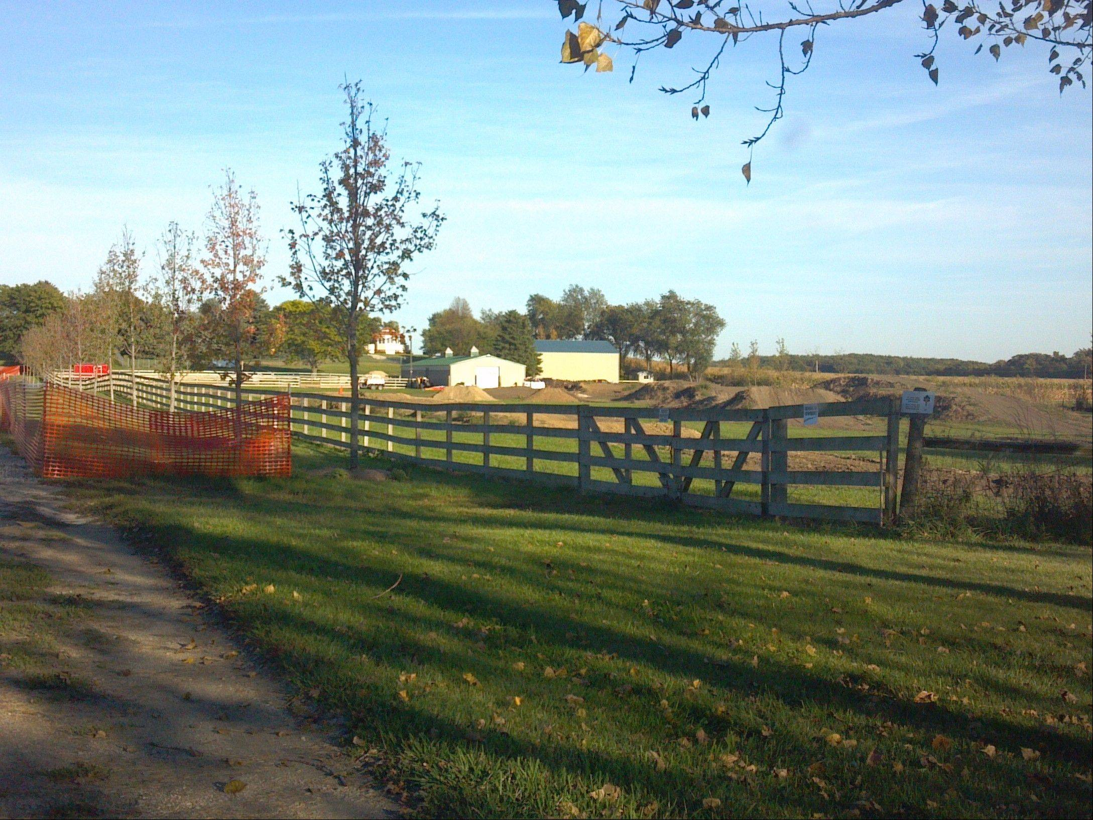 The view from an access road into Epona Farm in Maple Park is near a neighbor's motocross track, the subject of a lawsuit by the horse farm owner, claiming the motorcycles there scare her horses and have damaged her business.