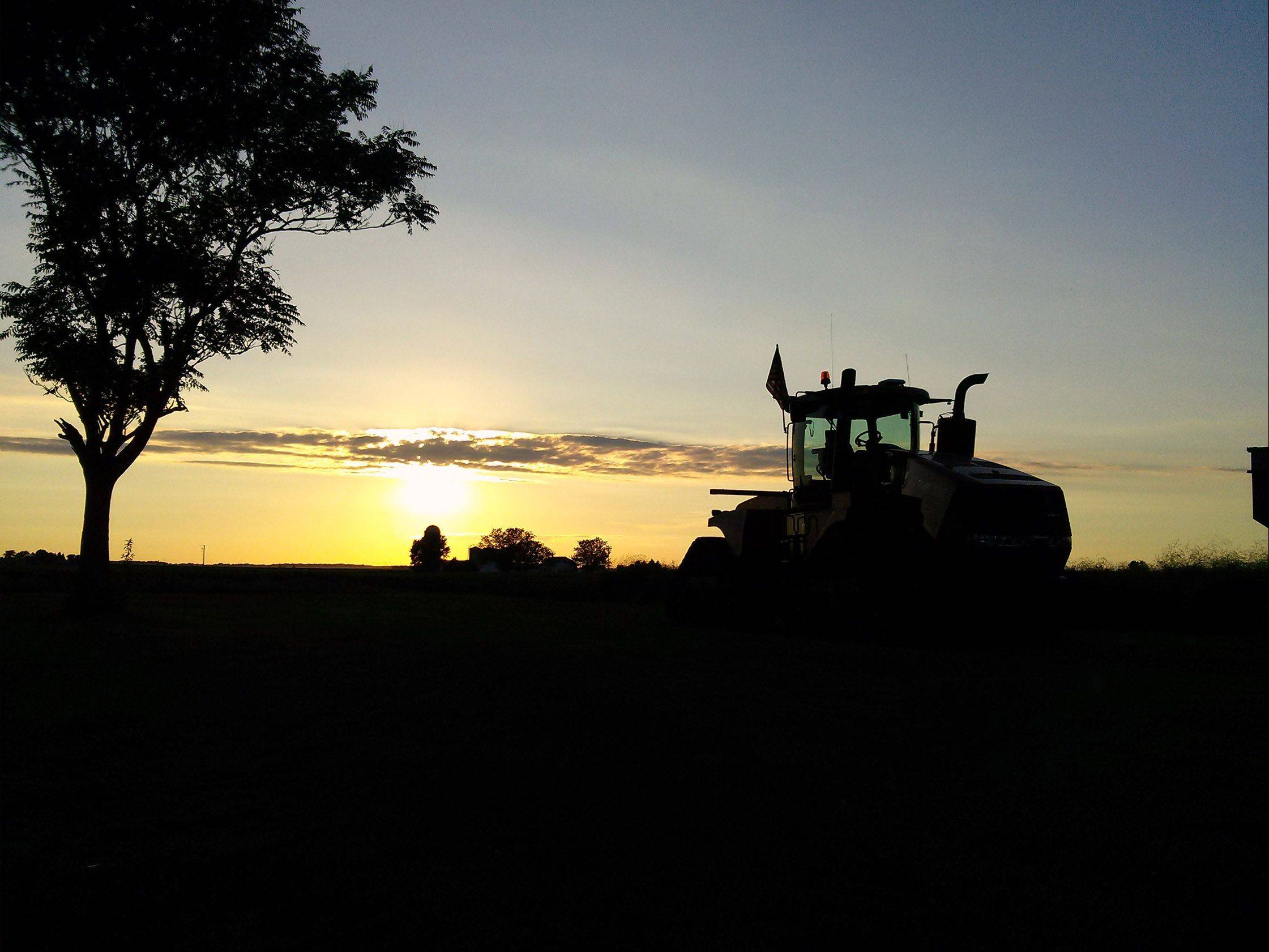 A large tractor is situated on the Phillips family farm at sunset in Sandwich, Ill. on August 10th.