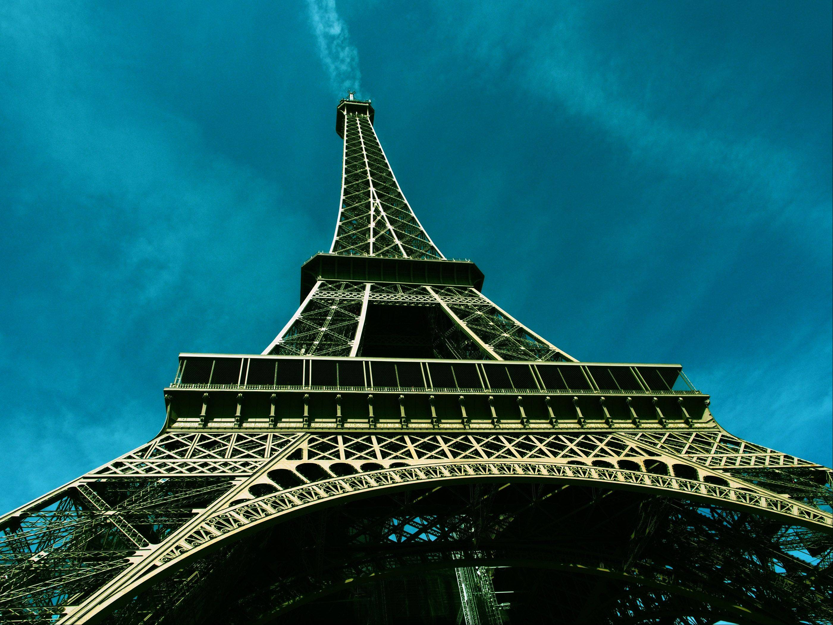 I took the photo of the Eiffel Tower in April and just happened to catch a jet plane's contrail intersecting the top of the tower.