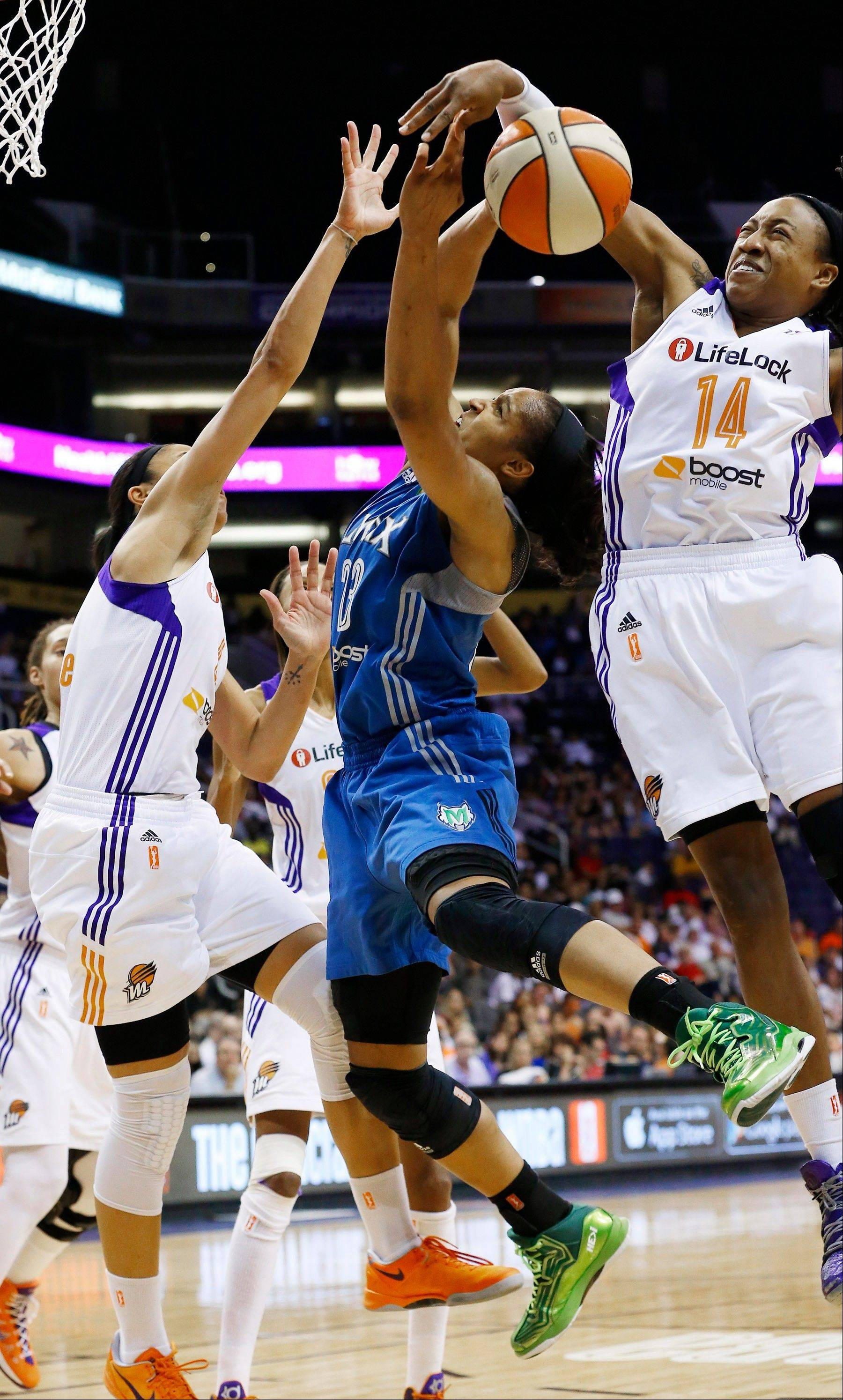 The Minnesota Lynx's Maya Moore, center, is one of the most impressive WNBA players that Patricia Babcock McGraw has seen this season.